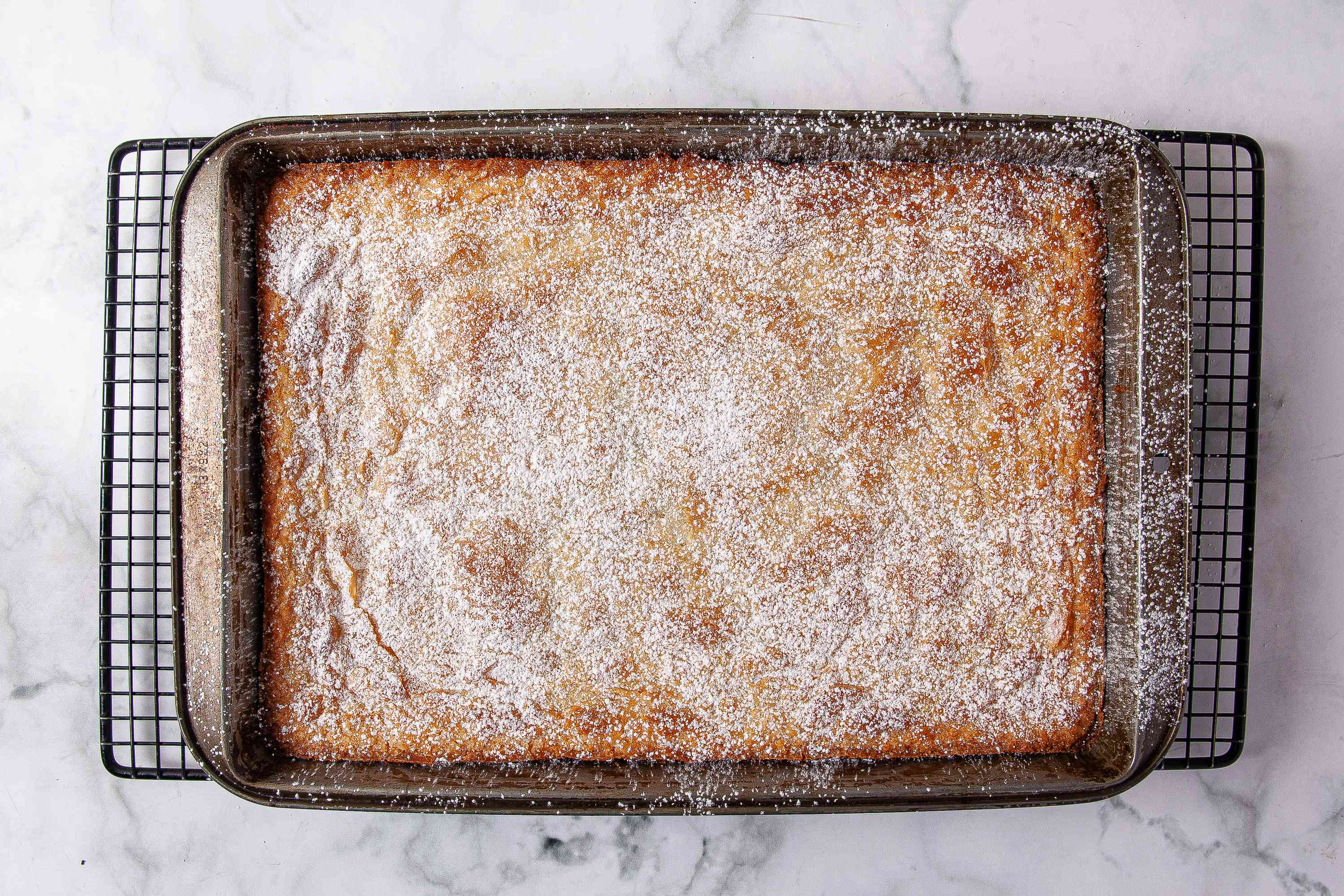 Dust with powdered sugar, cut and serve the delicious Gooey Butter Cake