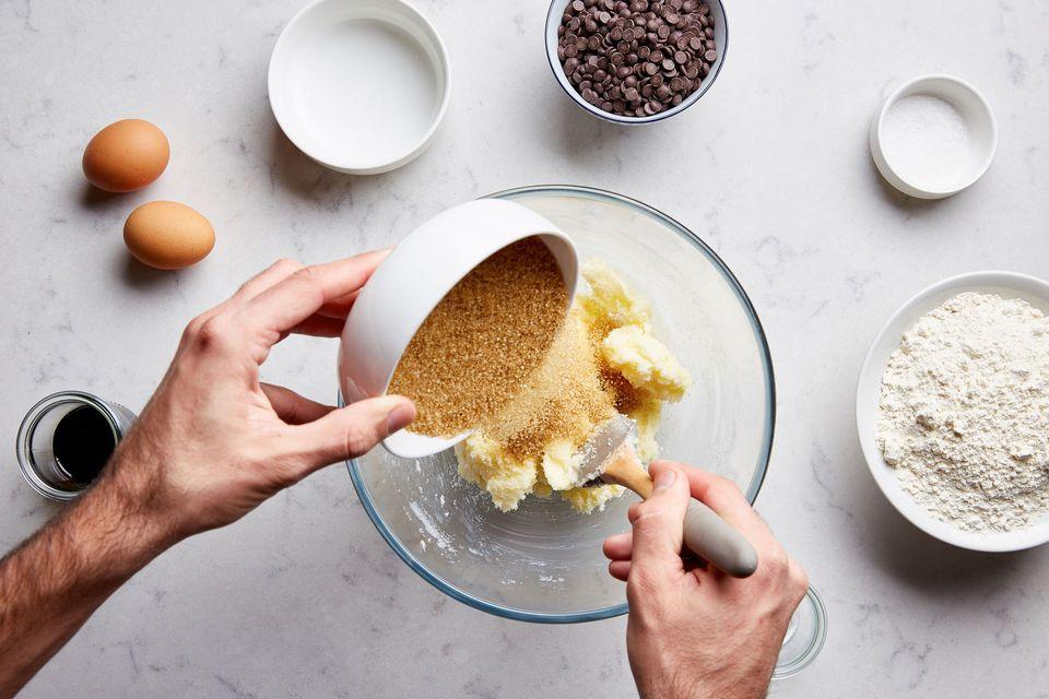 Adding sweetener to bowl of ingredients