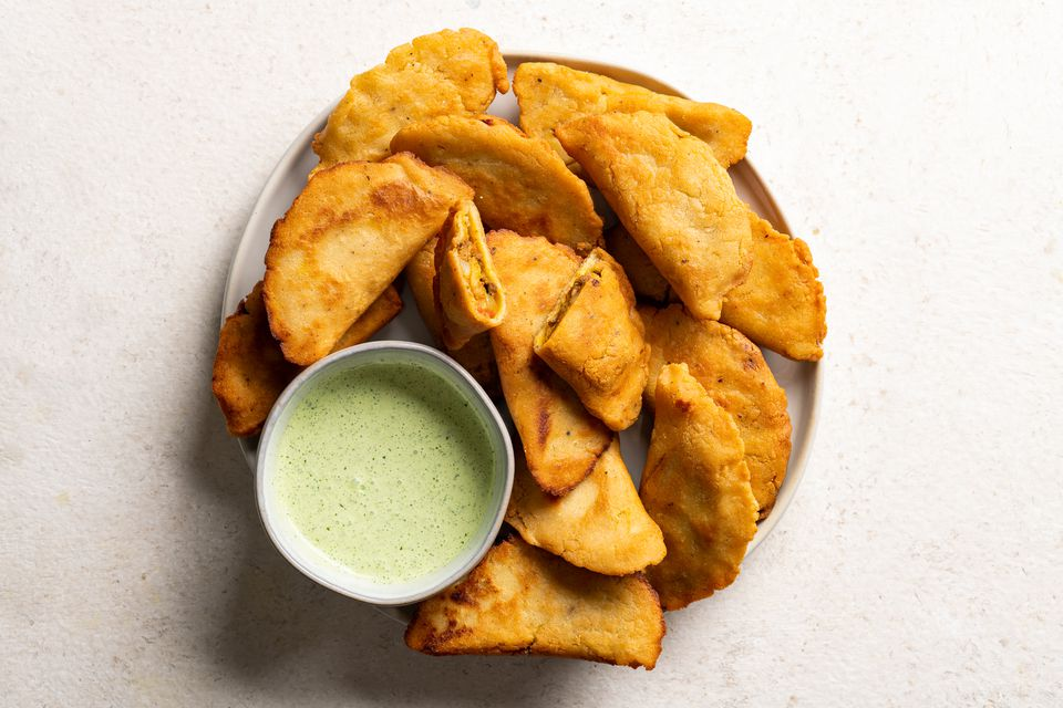 Colombian Empanadas: Fried Empanadas With Beef and Potato Filling on a platter