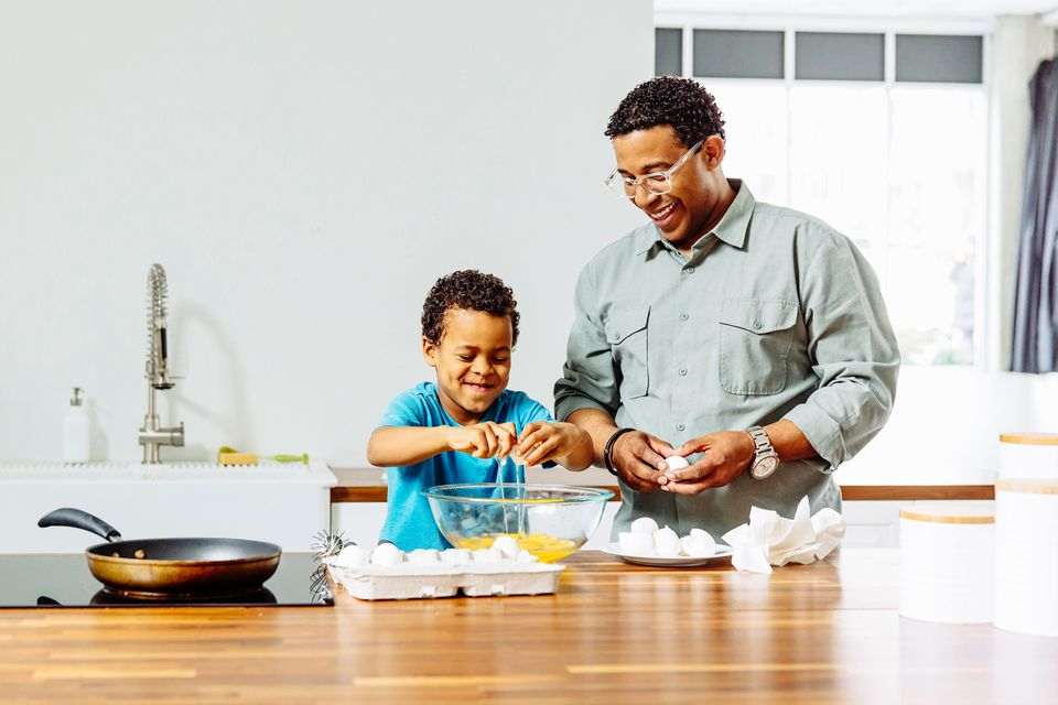 Father cooking with son