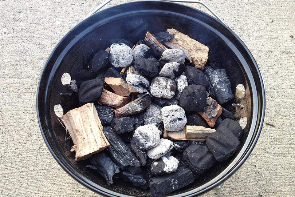 In the bottom of the Smokey Joe, unlit charcoal (lump and briquettes) and hickory wood