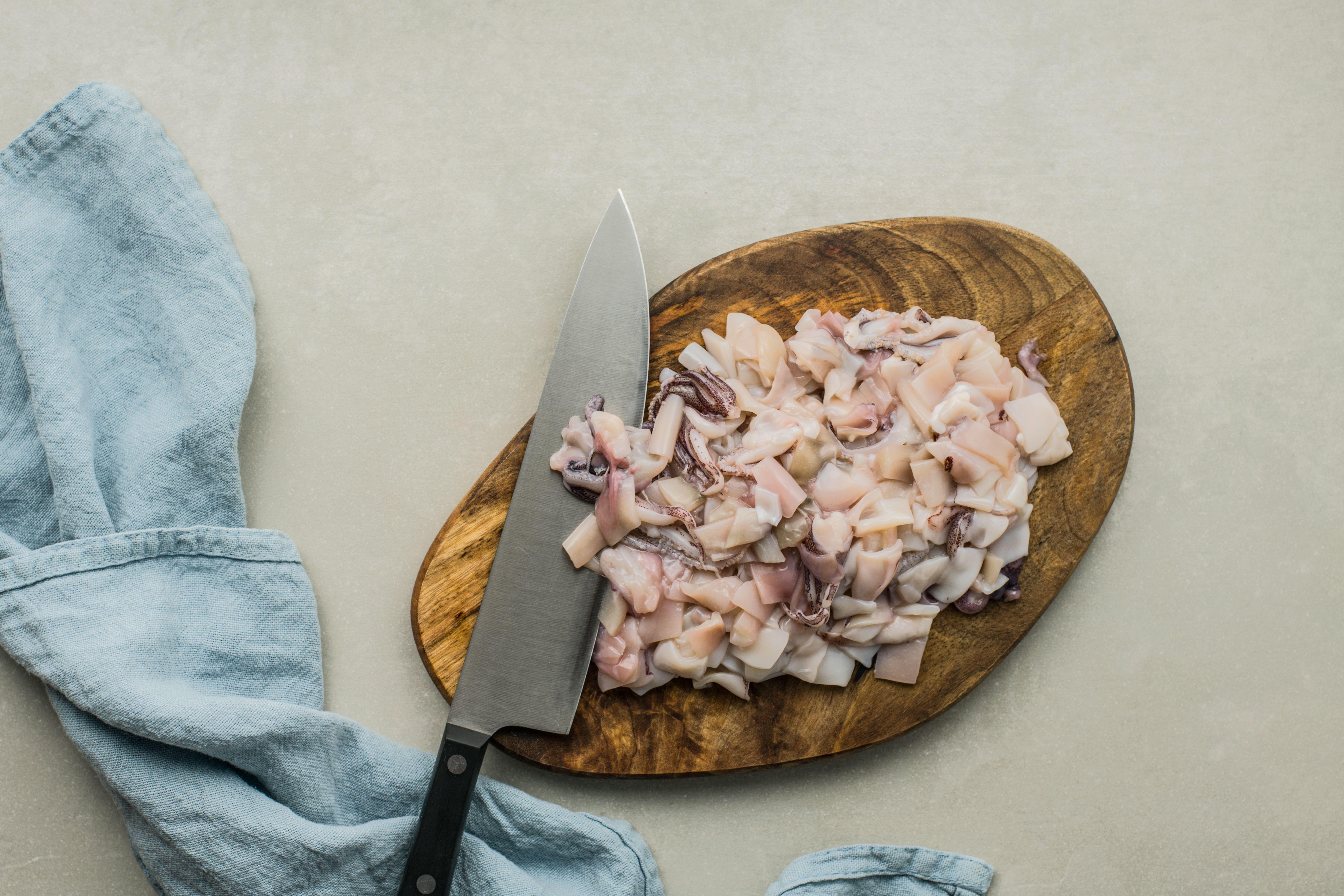 Diced squid on a cutting board