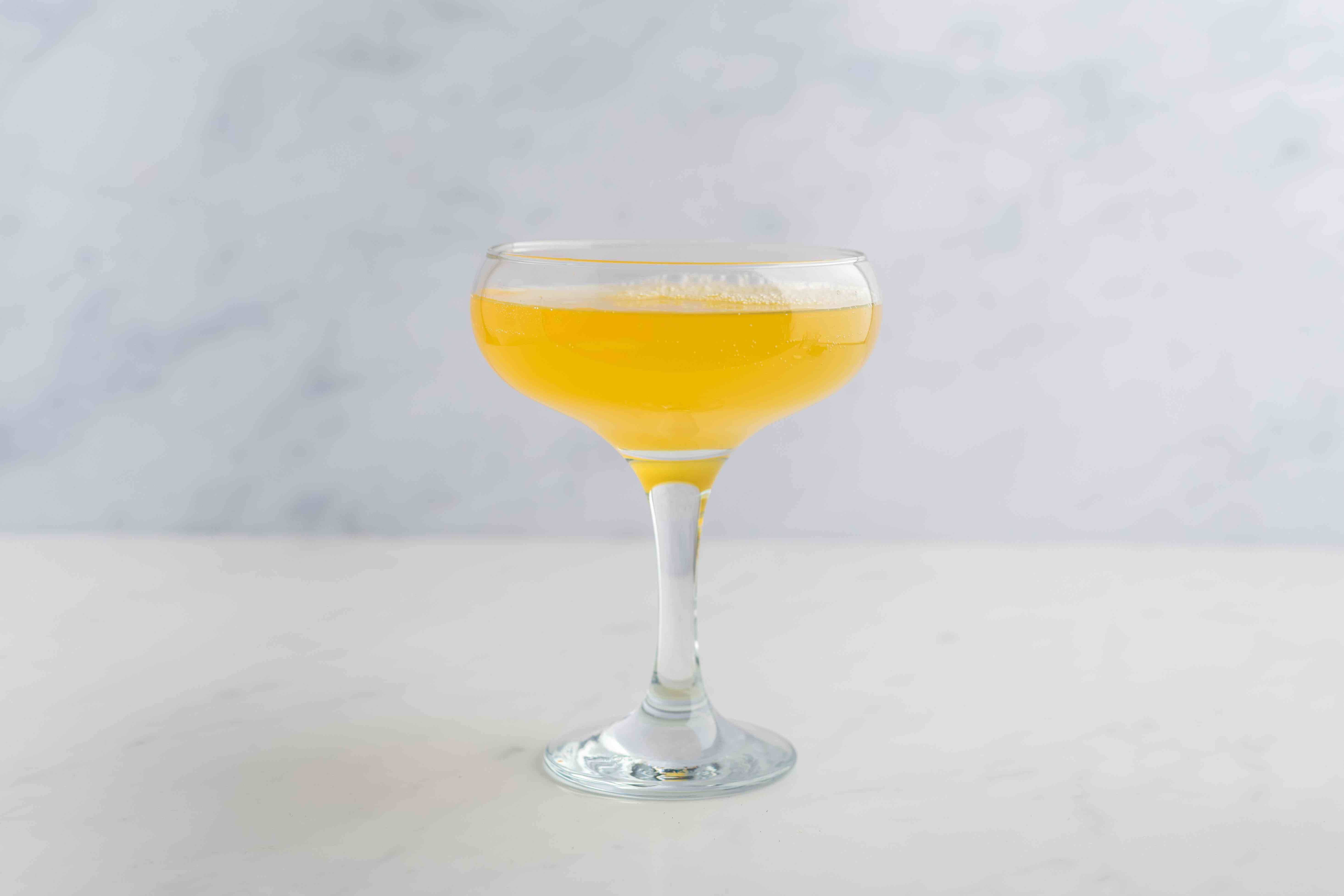 Champagne, vanilla liqueur and passion fruit juice in a glass