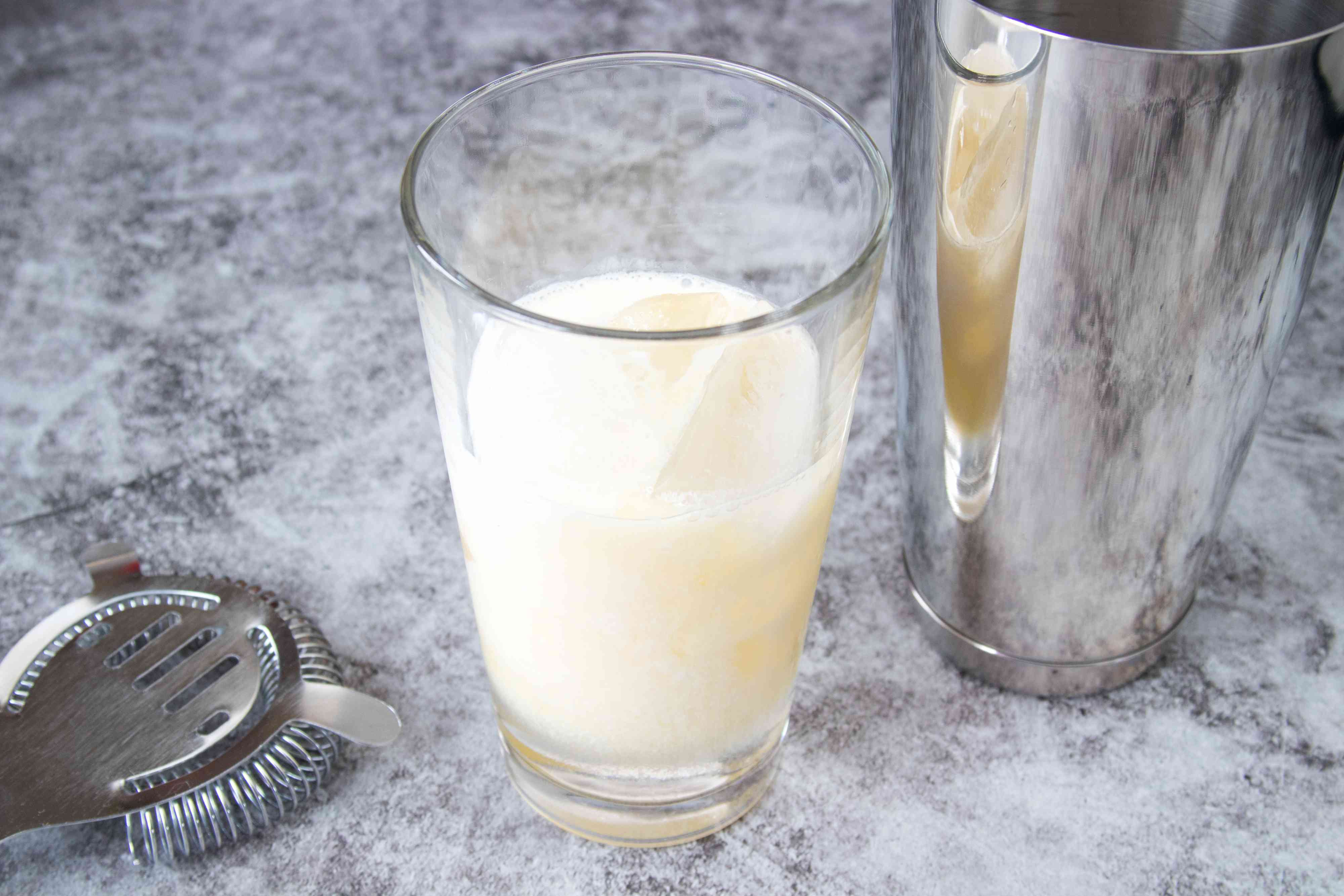 Mixing an orange creamsicle cocktail