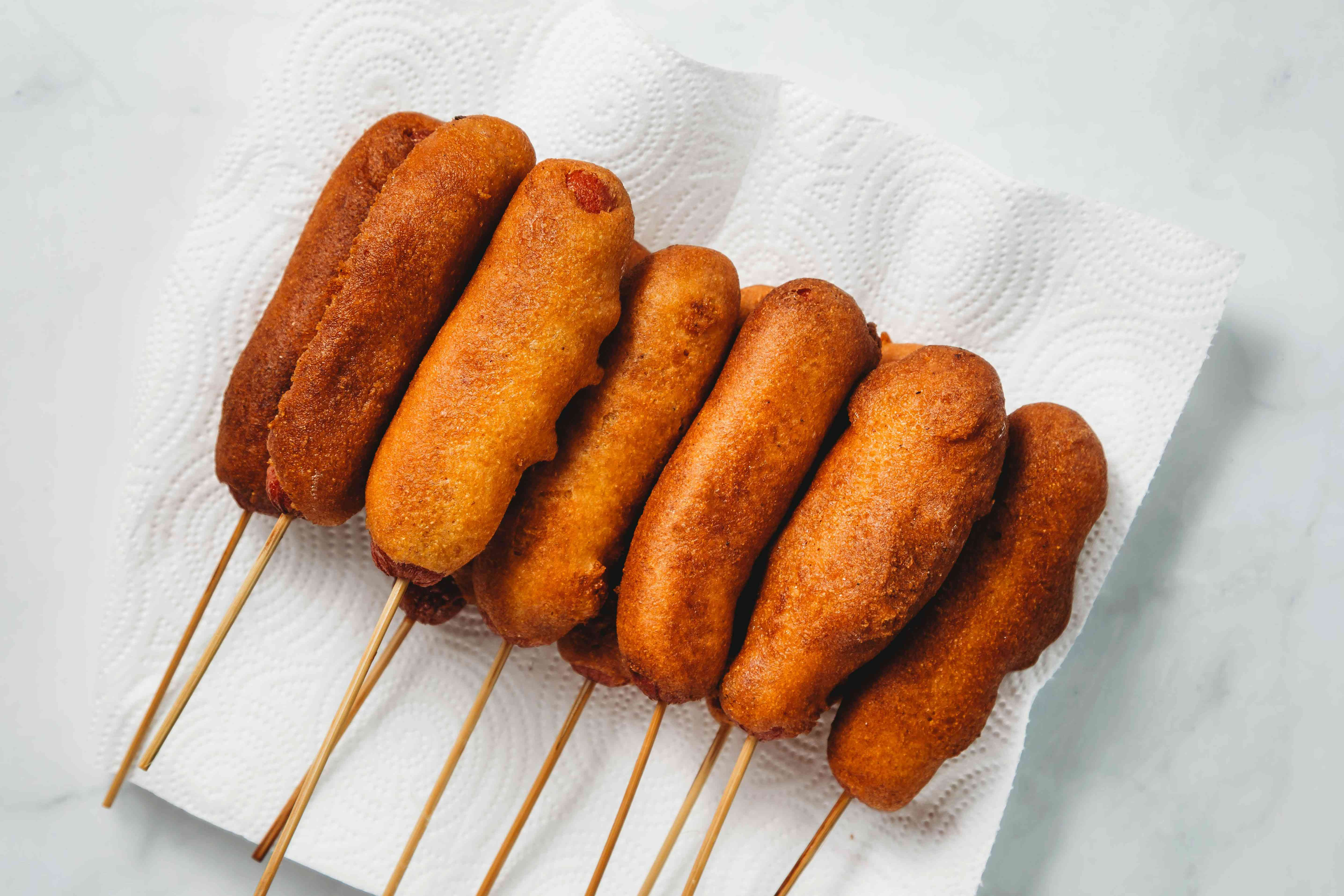 Deep Fried Corn Dogs on paper towels