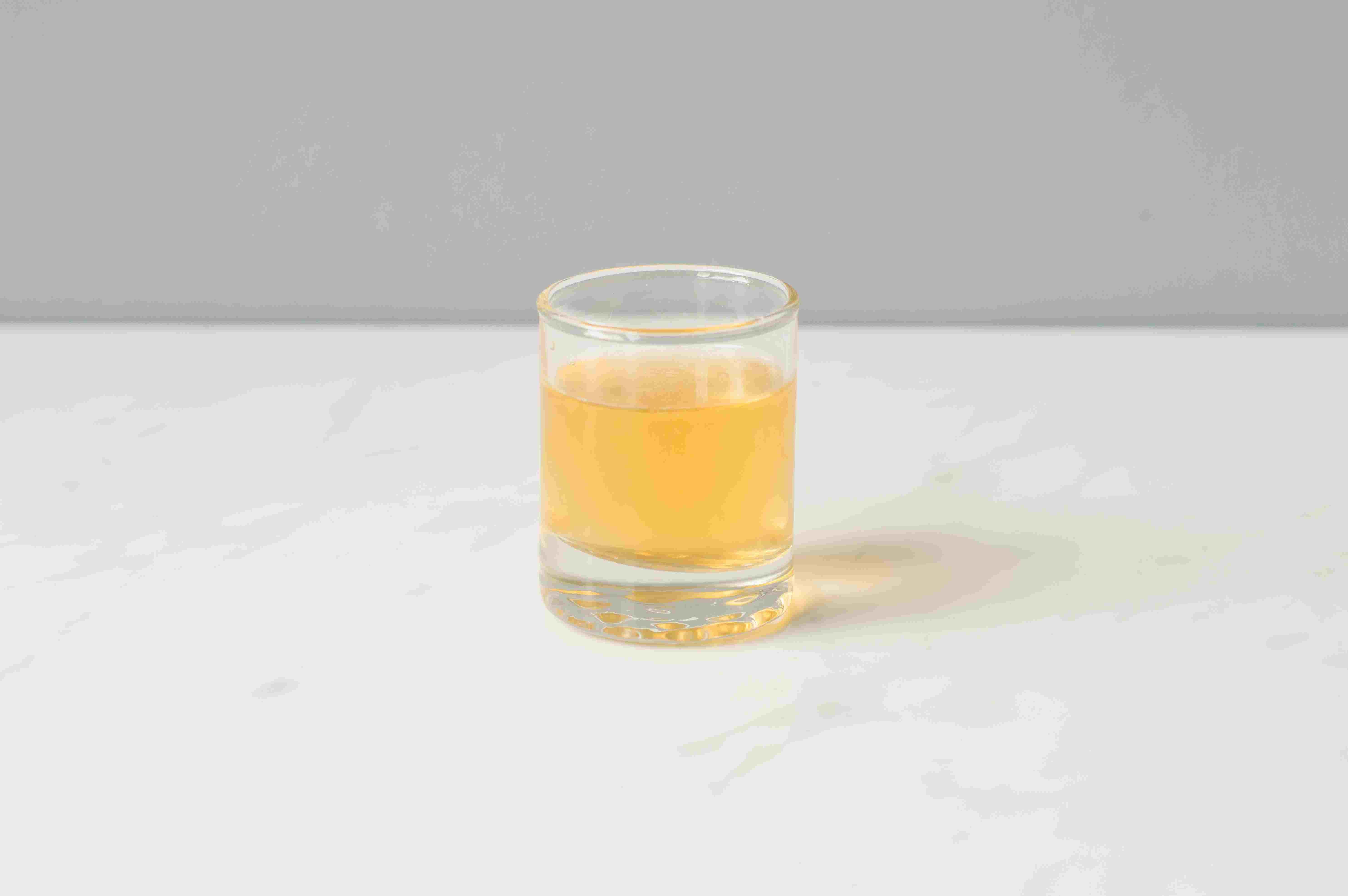 Strain into a shot glass