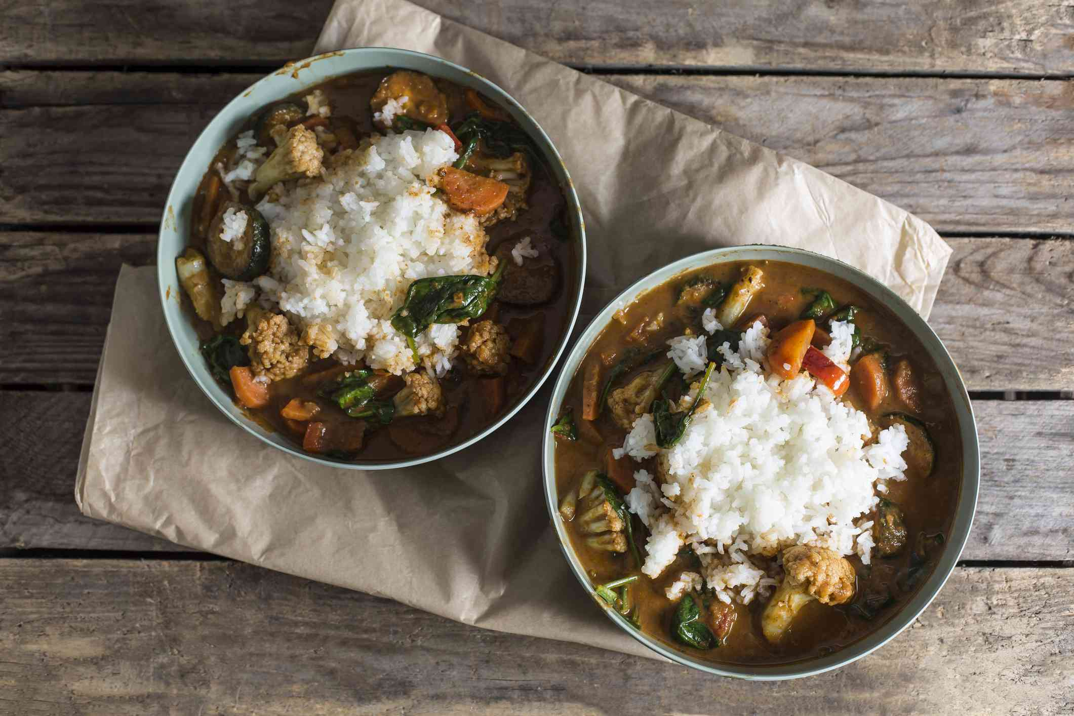 Two bowls of Garam Masala vegetable curry dish with jasmine rice
