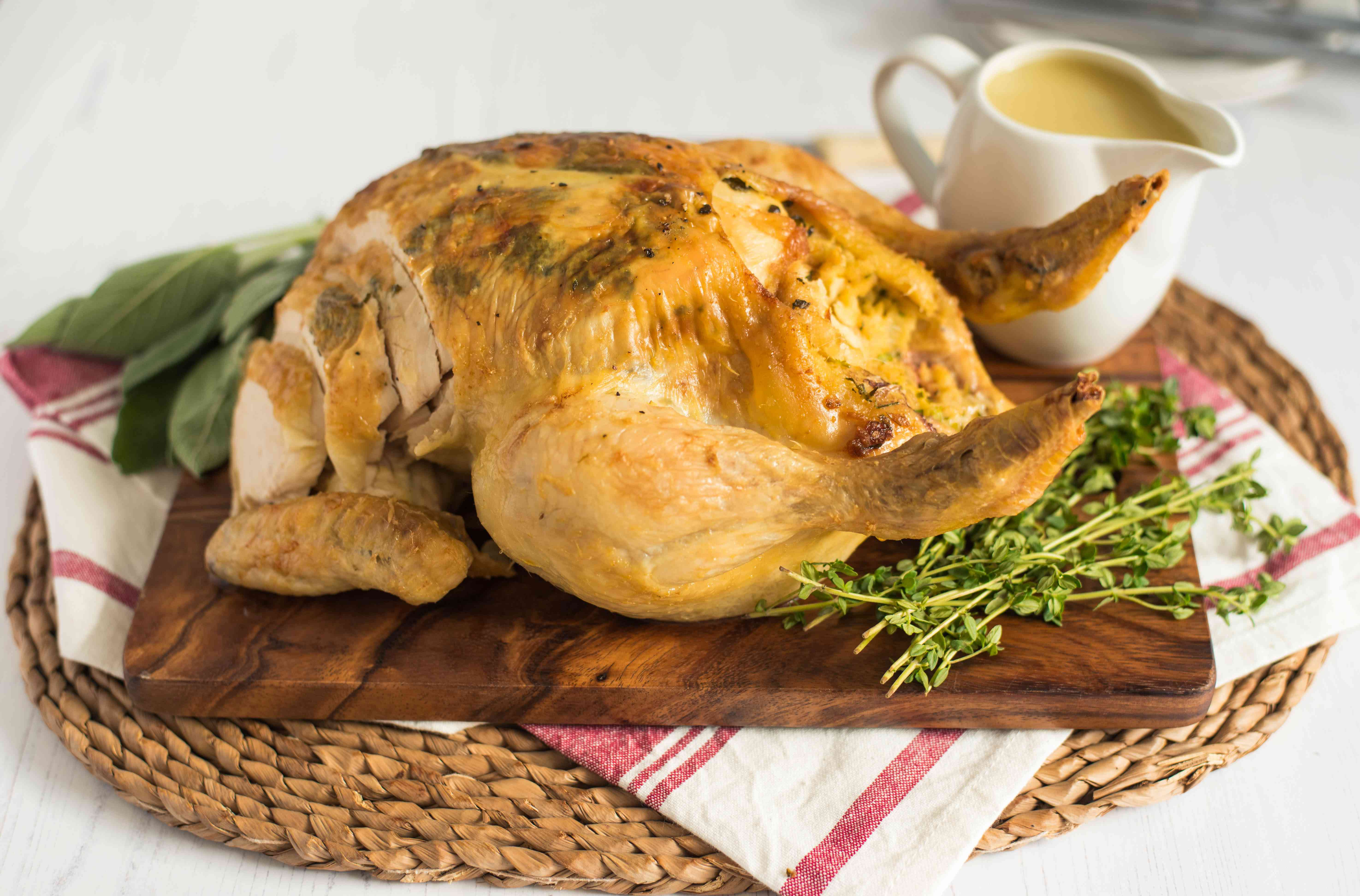 Whole stuffed chicken with pan gravy