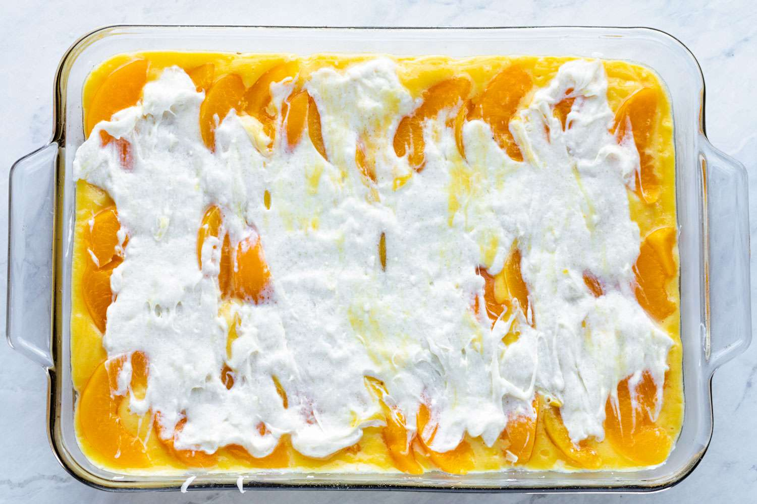 beat the cream cheese, sugar, and 3 tablespoons of the reserved peach syrup, and pour over peaches