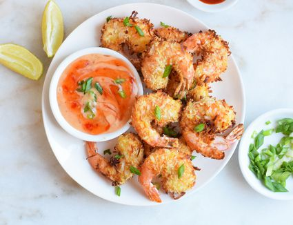 air fryer coconut shrimp served with dipping sauce
