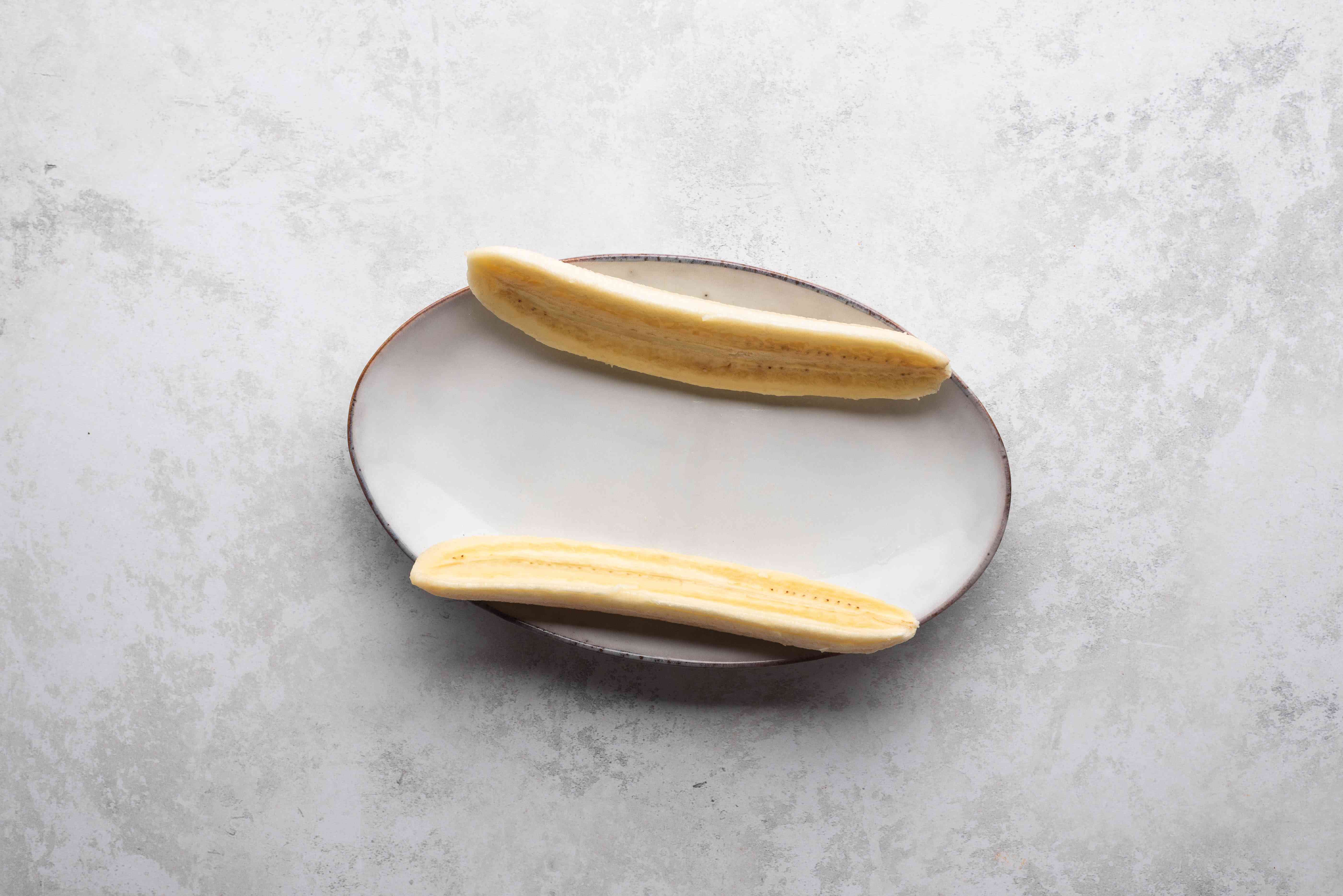 Banana sliced and placed in a narrow dish