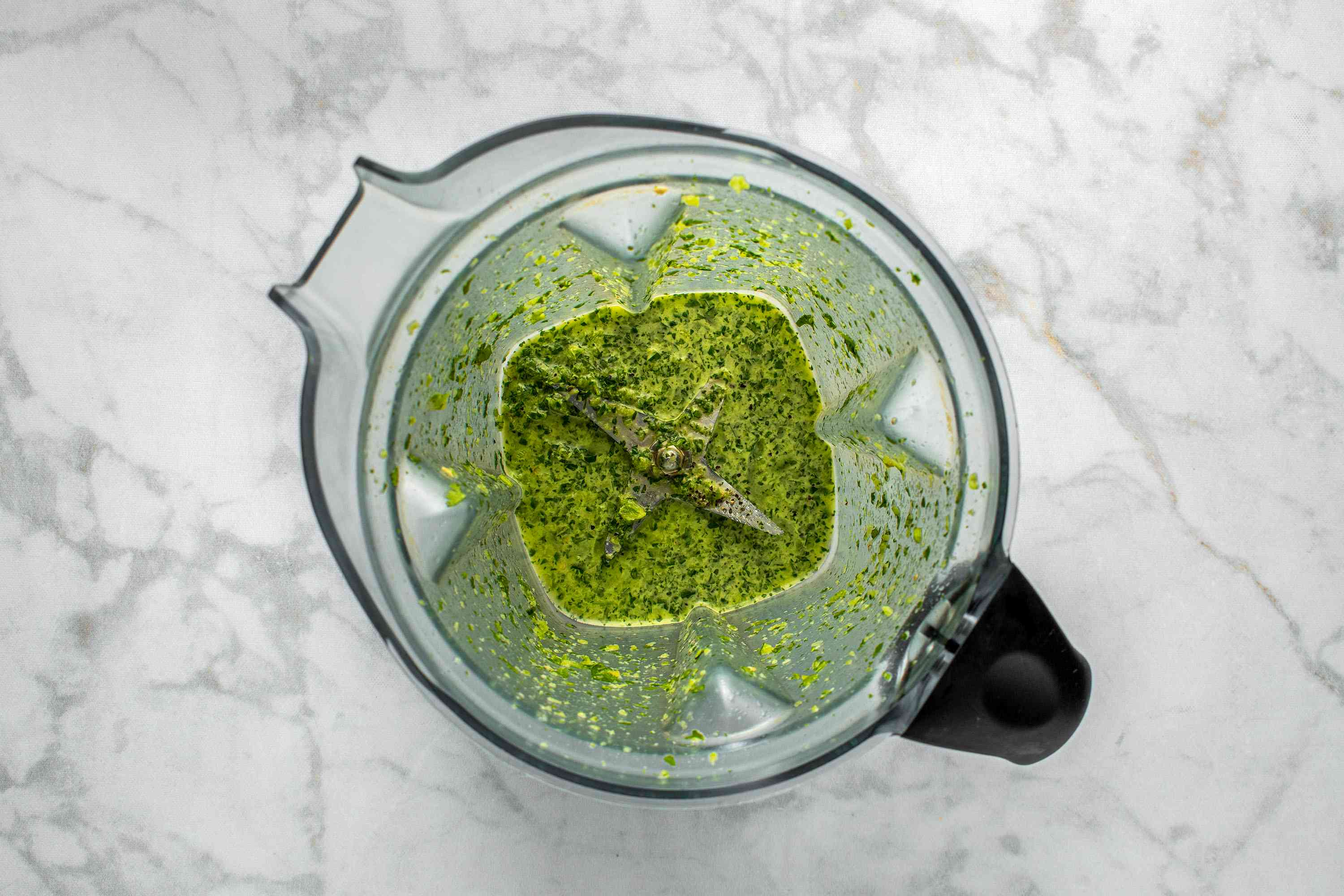 Combine water, cilantro, jalapeno, lime juice, and olive oil in a blender