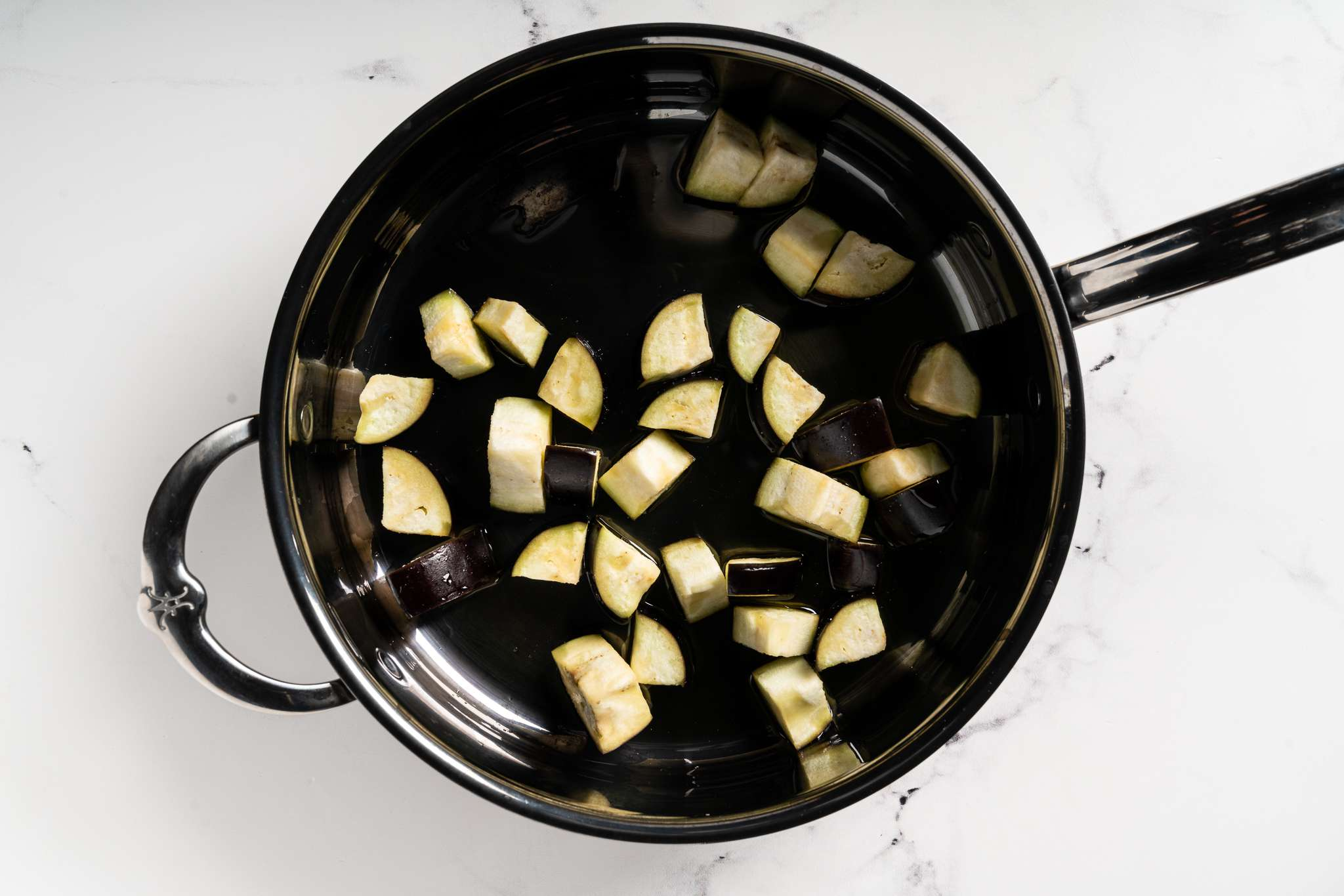 Eggplant in a skillet with oil