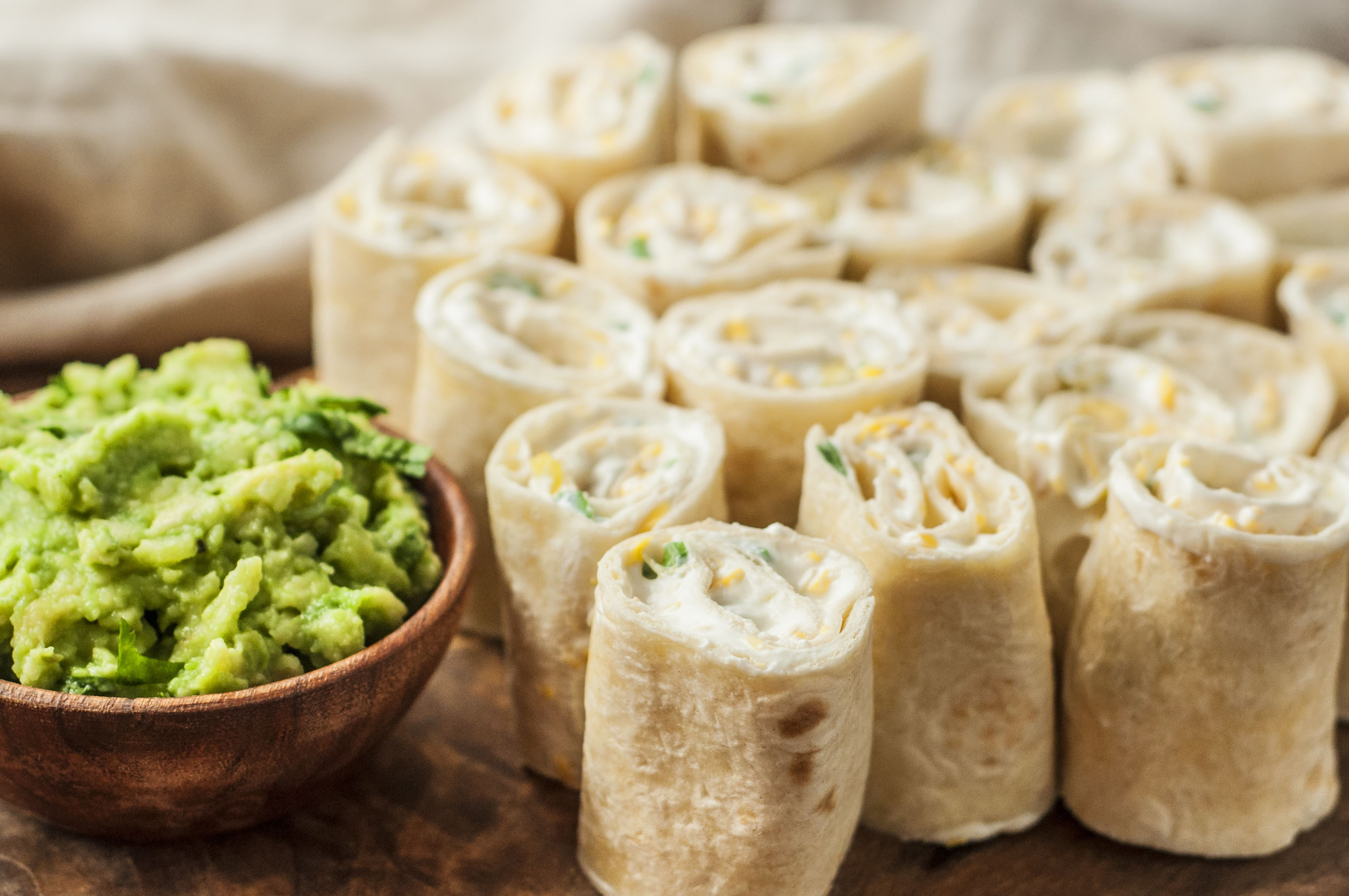 Tortillas sliced into pinwheels and served with guacamole