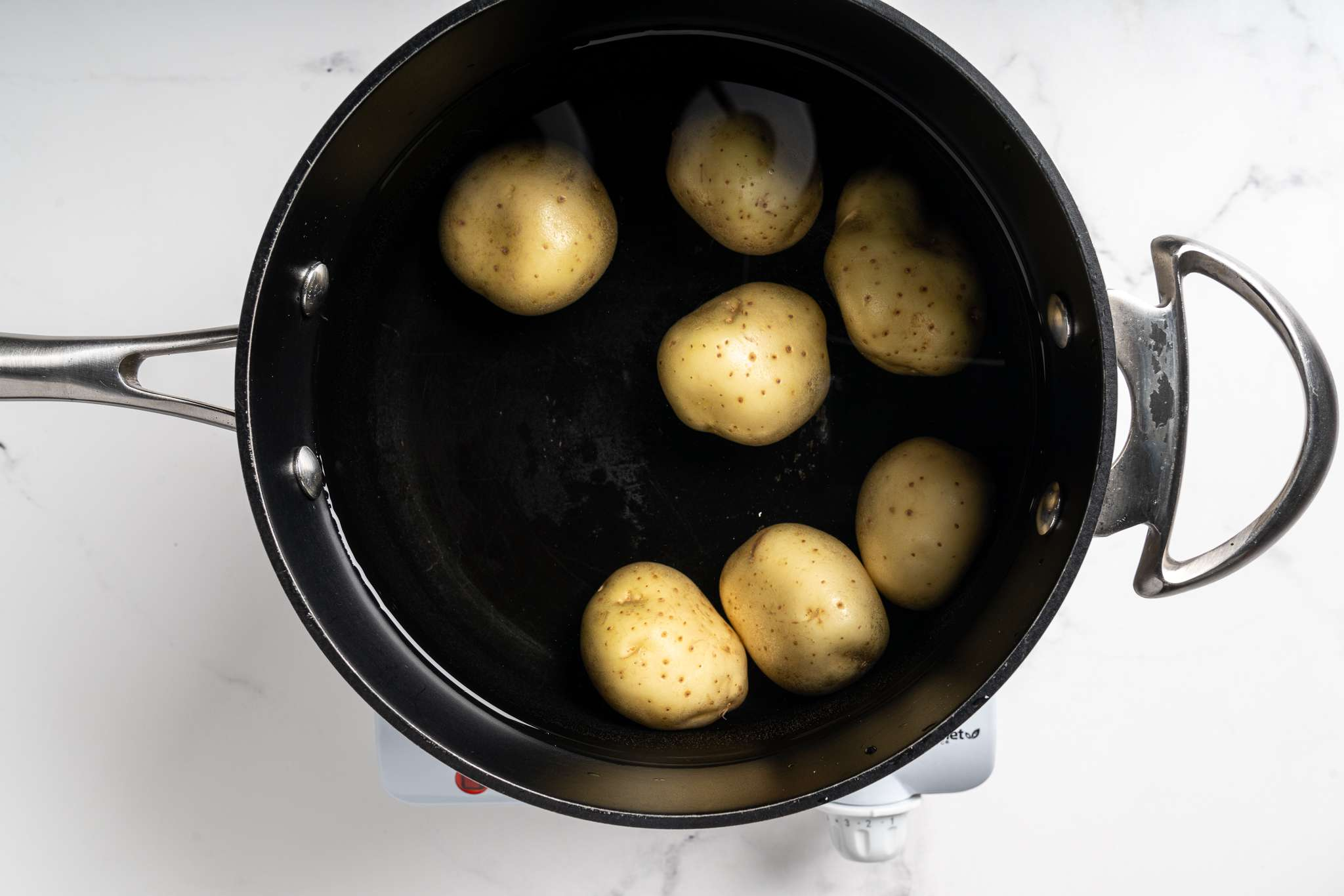 potatoes in a pot with water