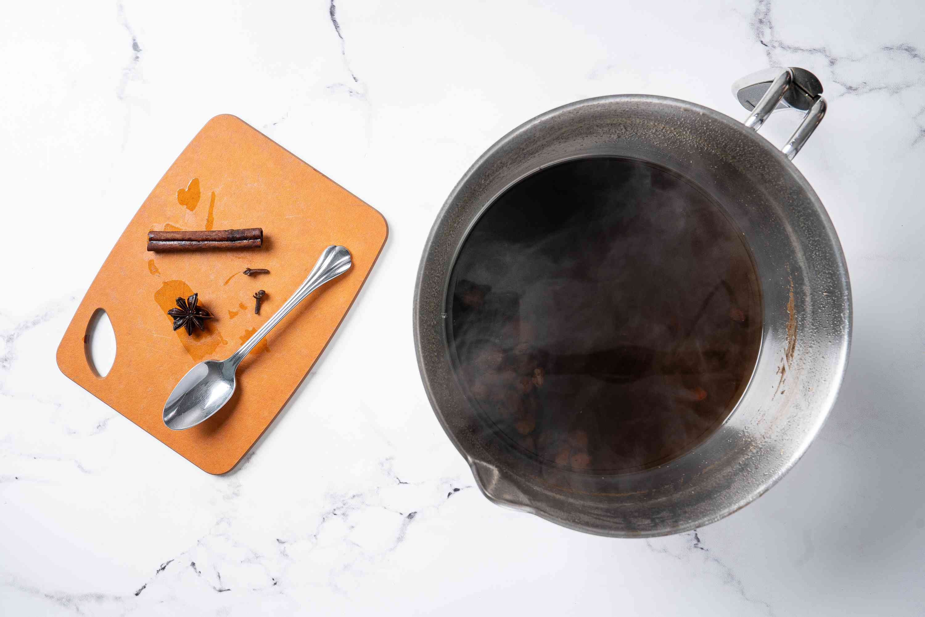 Hot syrup in a saucepan with spices removed