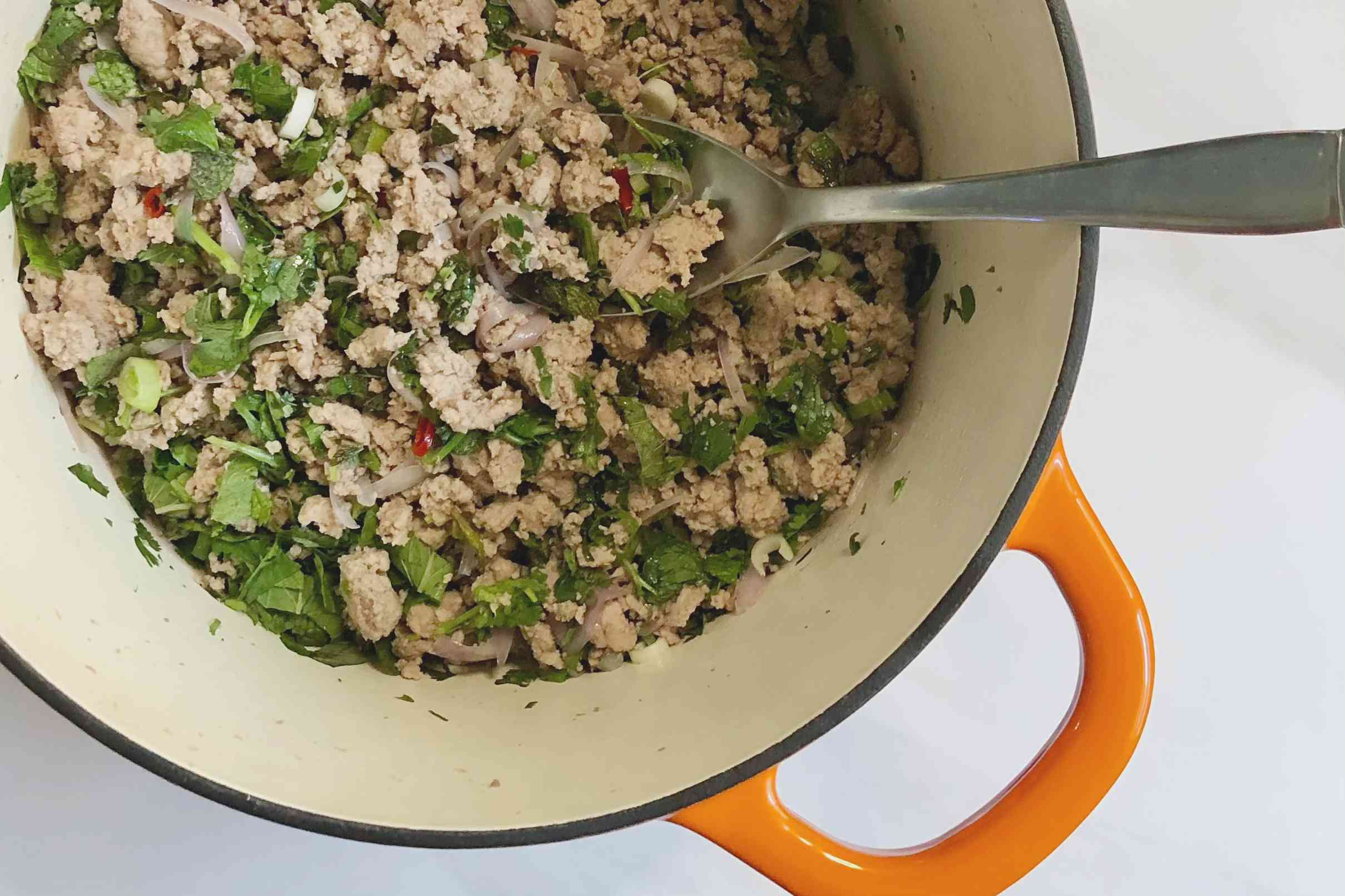 Ground turkey and spring onions in Dutch oven