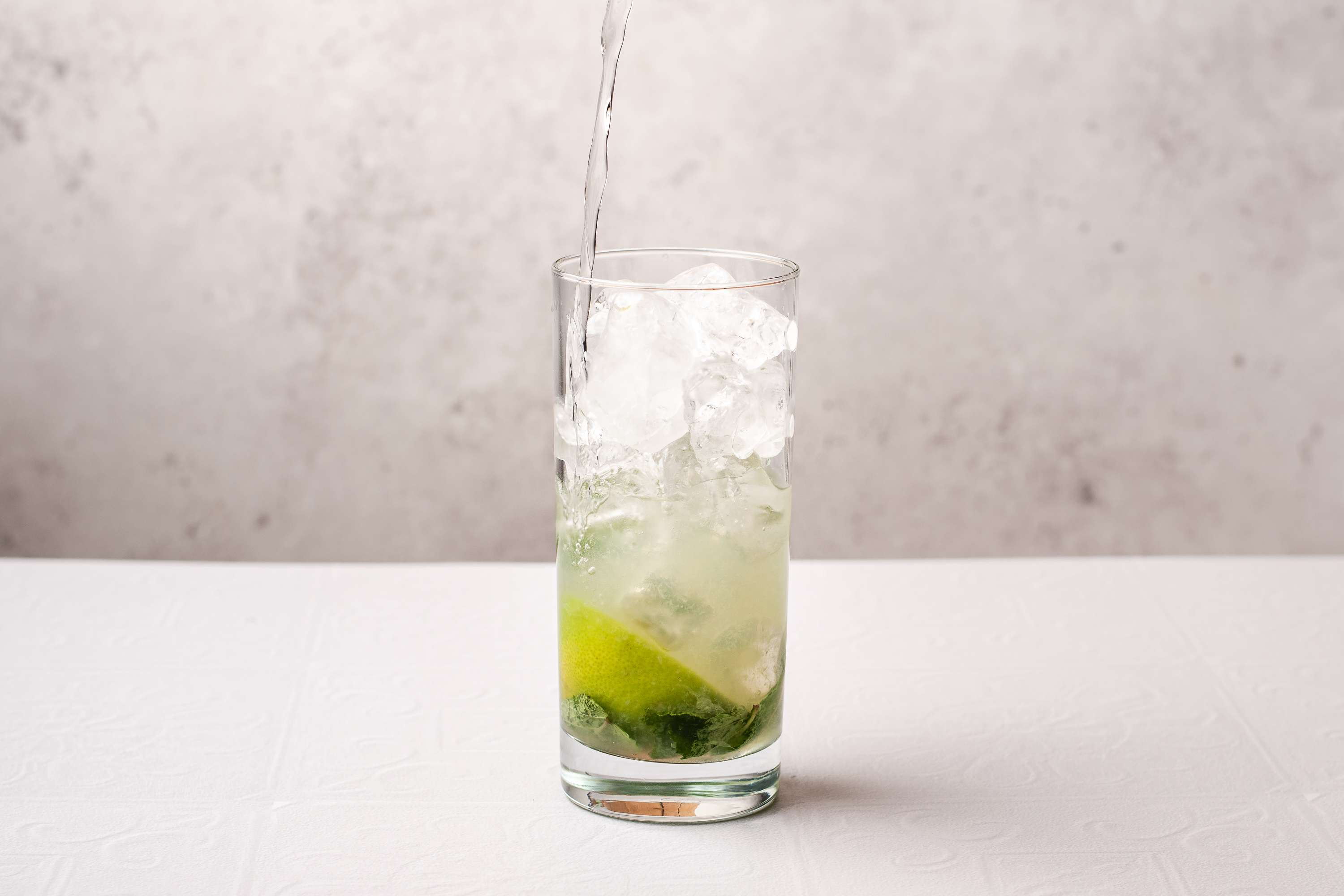add ice and soda to the glass