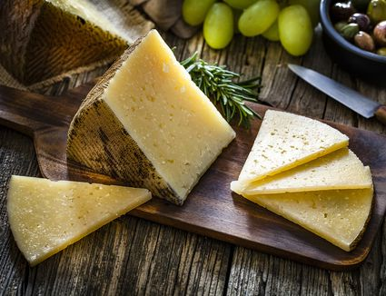 Manchego cheese on a wooden board