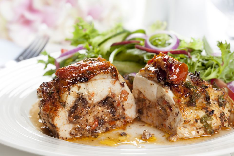 Stuffed Chicken Breasts with sauce and side salad