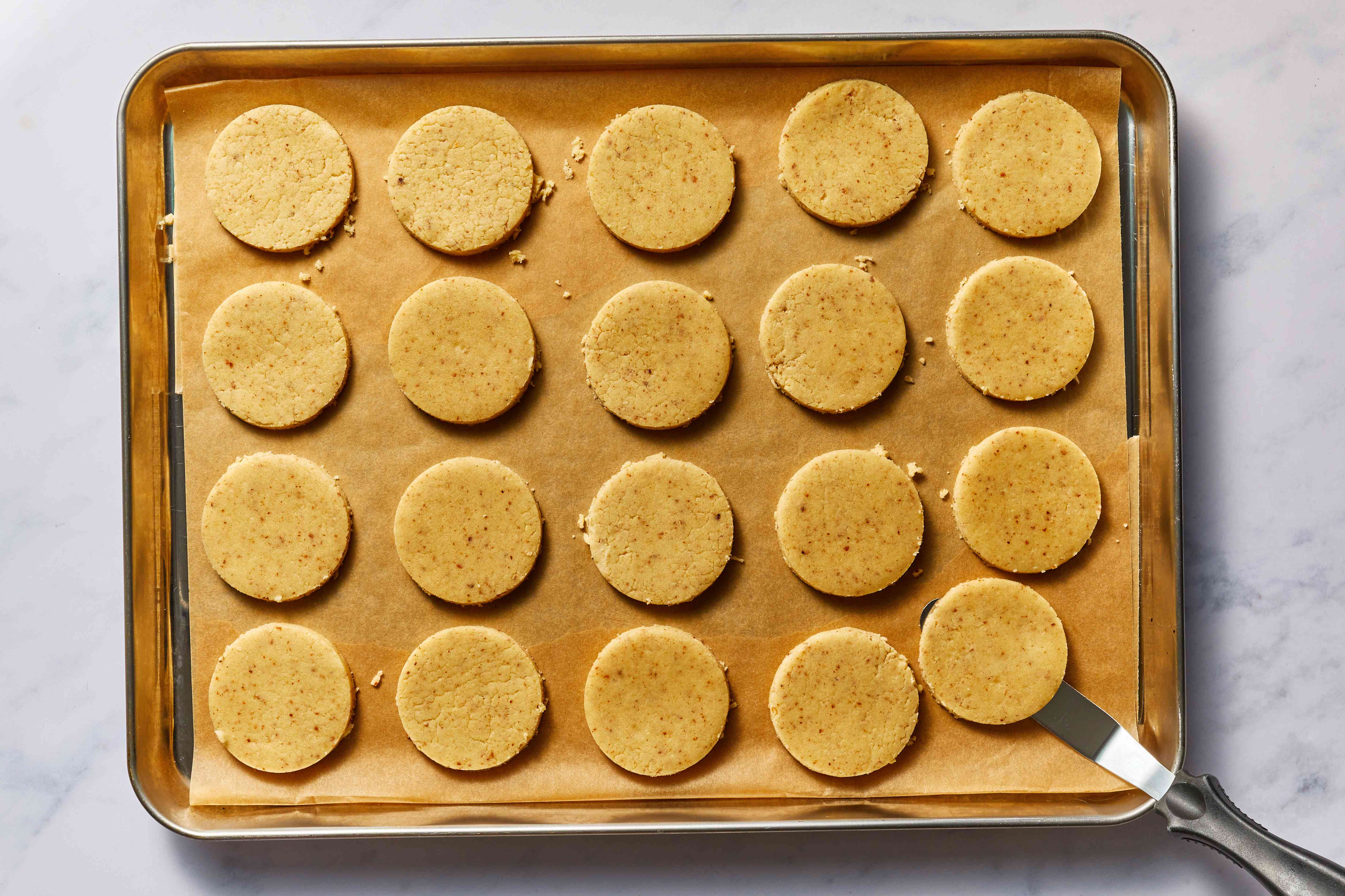raw cookies on a baking sheet
