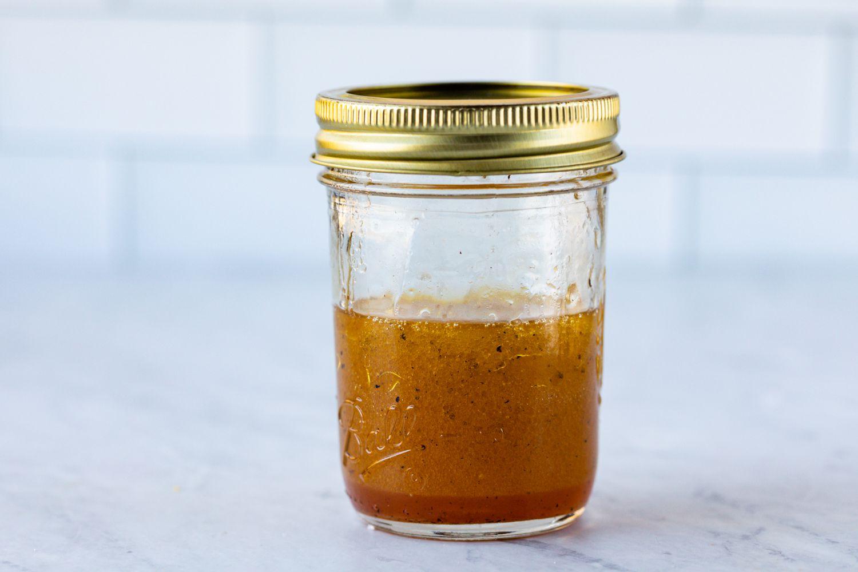 Place the oil, vinegar, salt and pepper in a screw-top jar