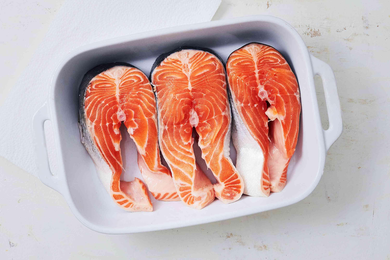 salmon steaks in a baking dish