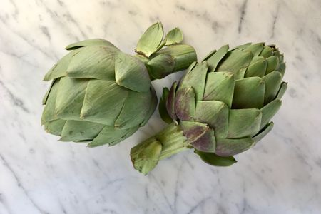 a step by step guide to trimming fresh artichoke hearts