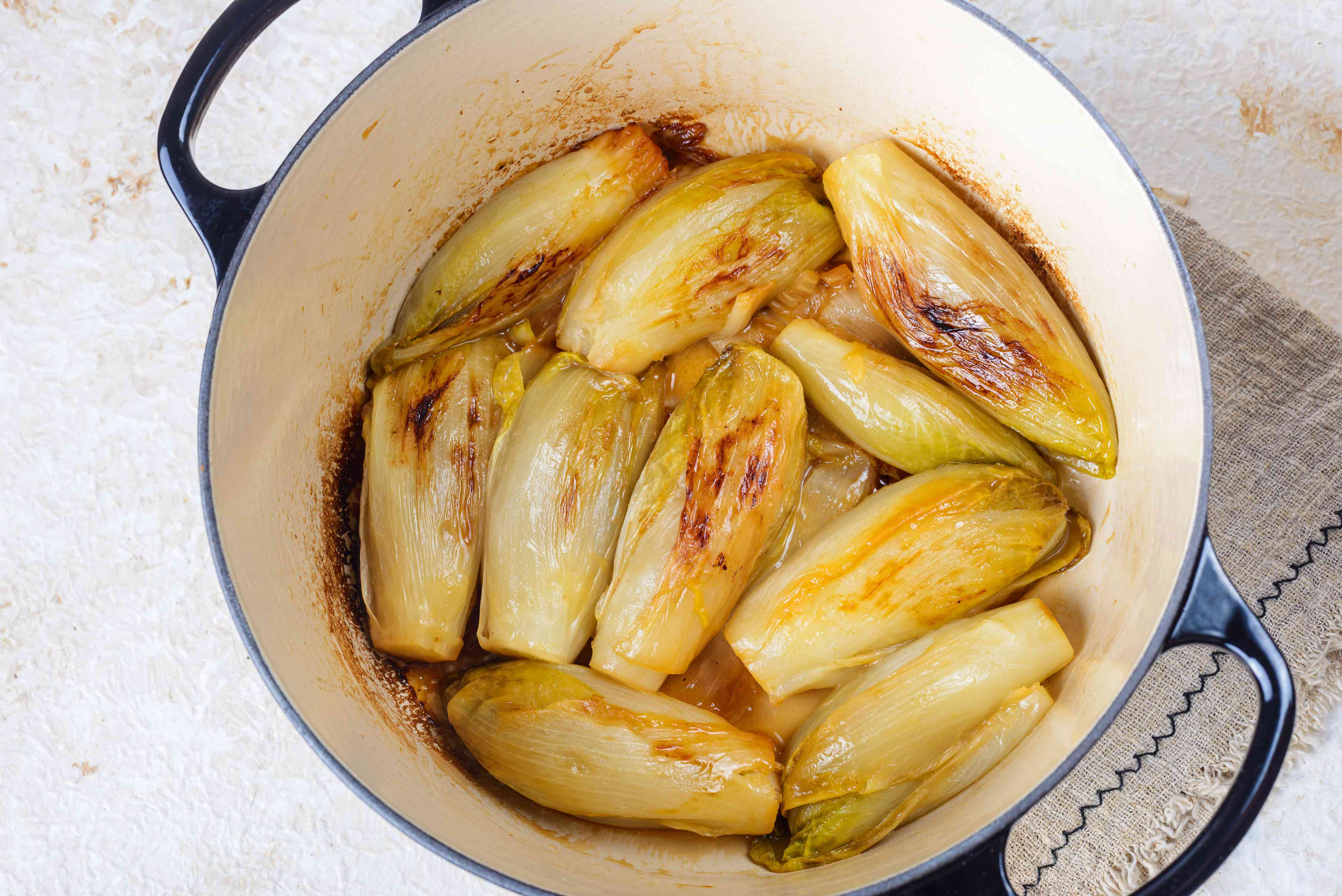Braised endives in pot