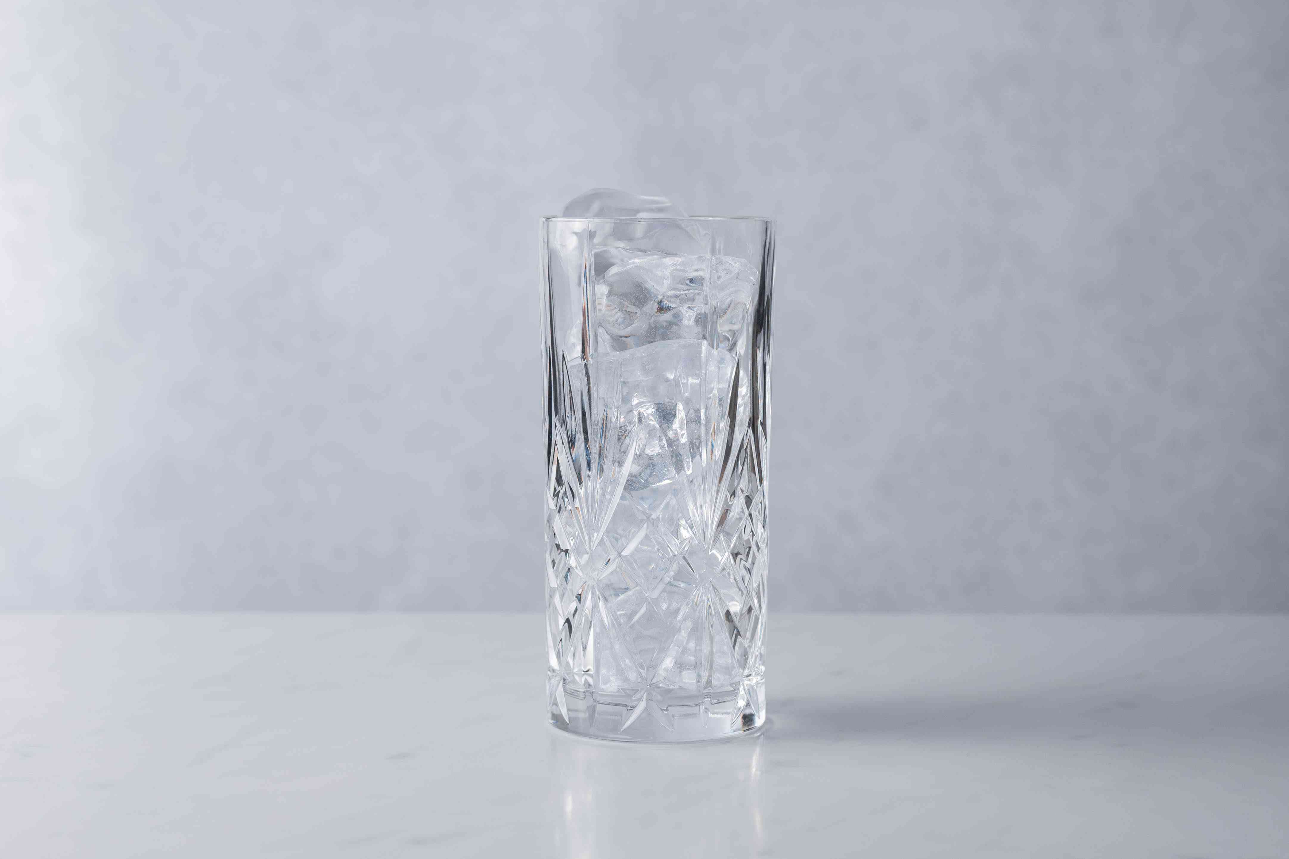 Fill a 12-ounce glass with ice cubes