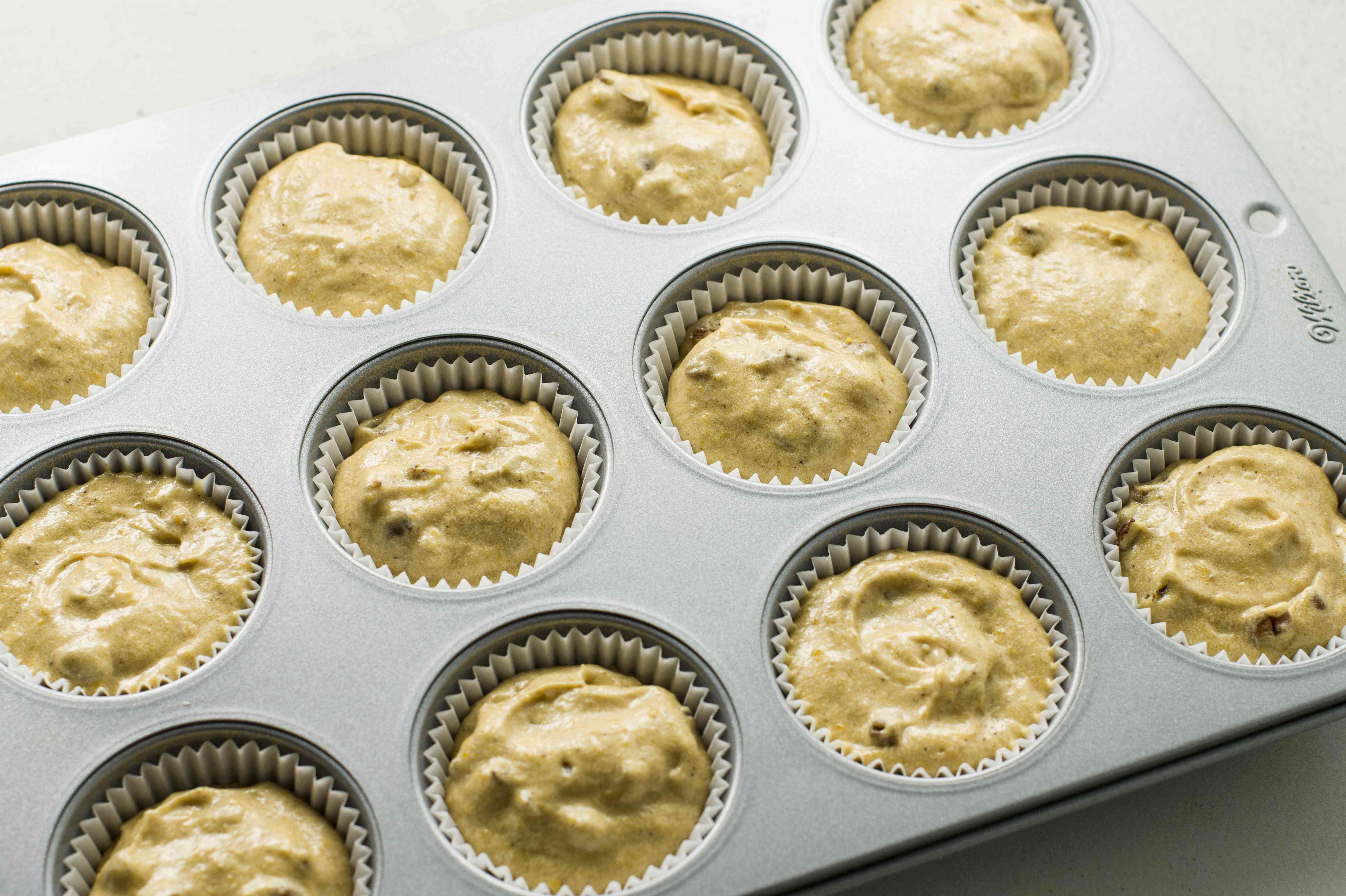 Fill lined muffin cups