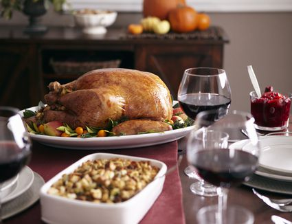 Turkey, stuffing, and cranberry dishes on table.