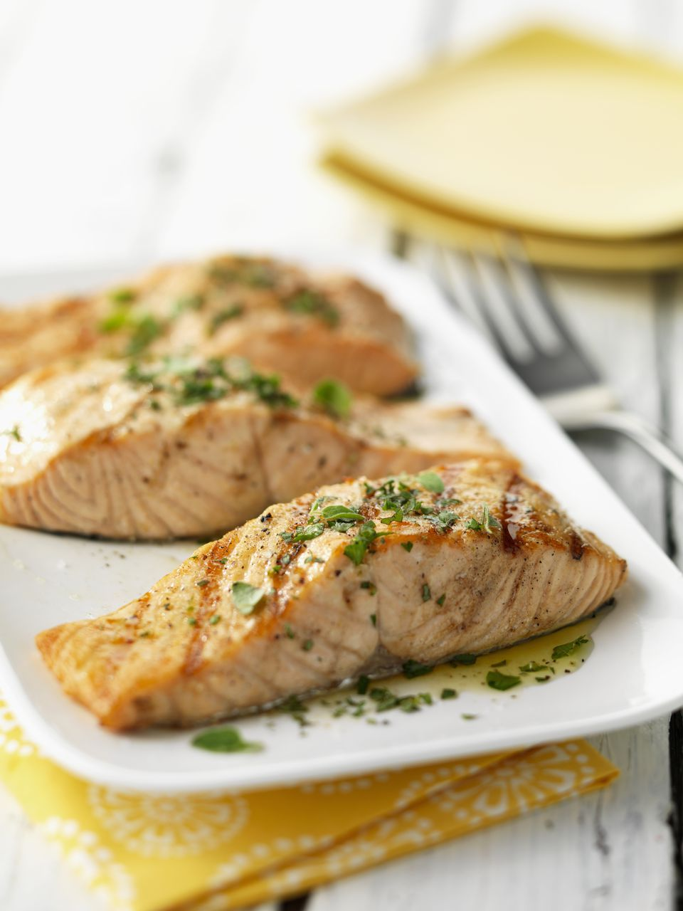 Salmon with a citrus-balsamic vinaigrette on a plate