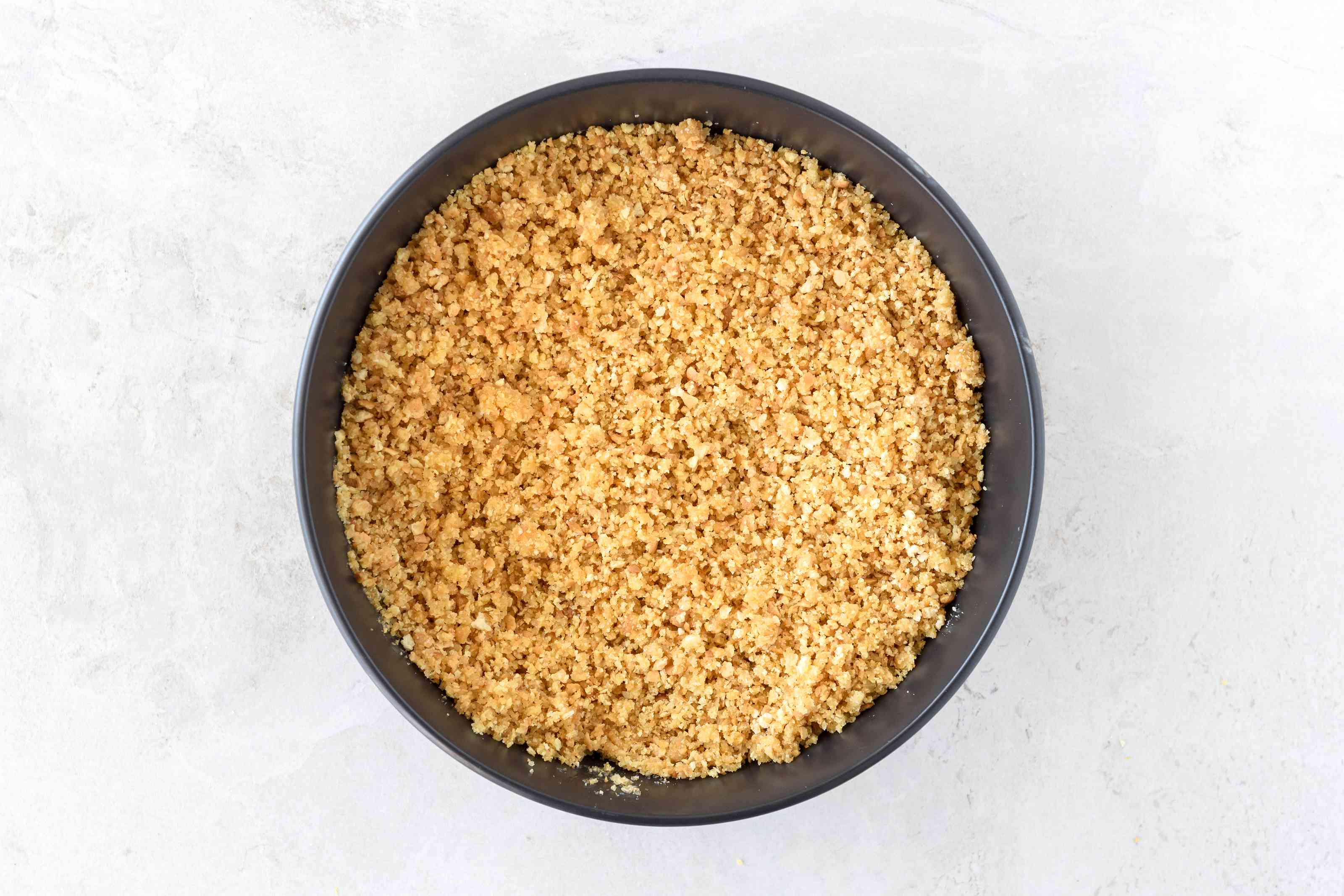 Dairy-free cheesecake crust ingredients combined in bowl