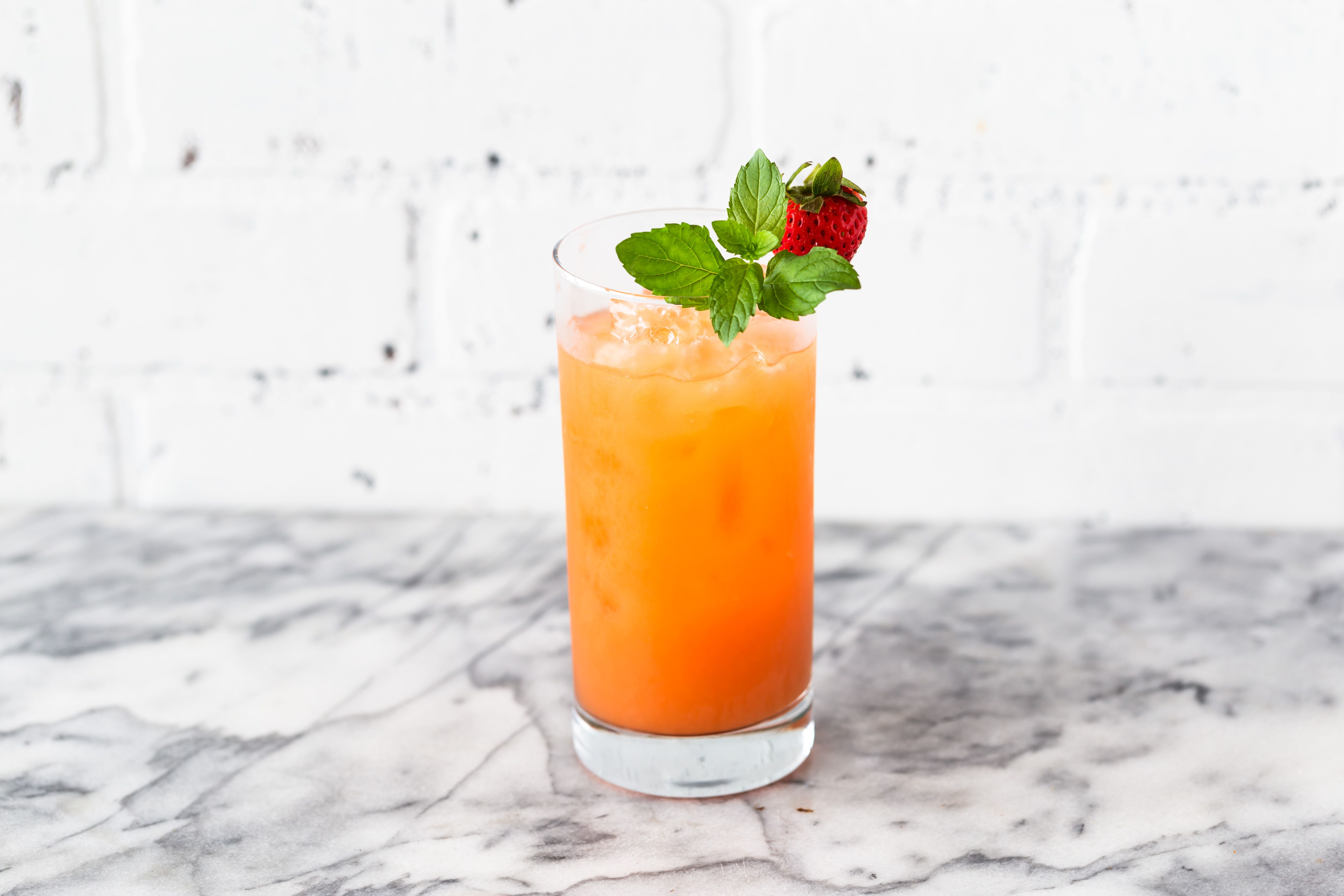 Garnished with fresh mint and a strawberry