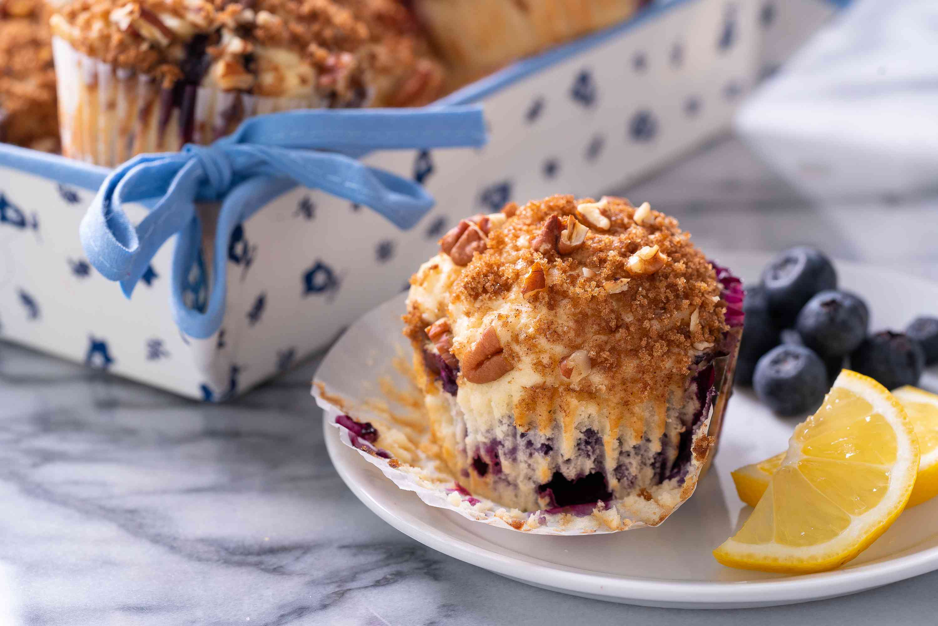 Lemon blueberry muffins on a serving plate
