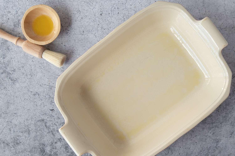 Grease a shallow 2 1/2 or 3-quart baking dish