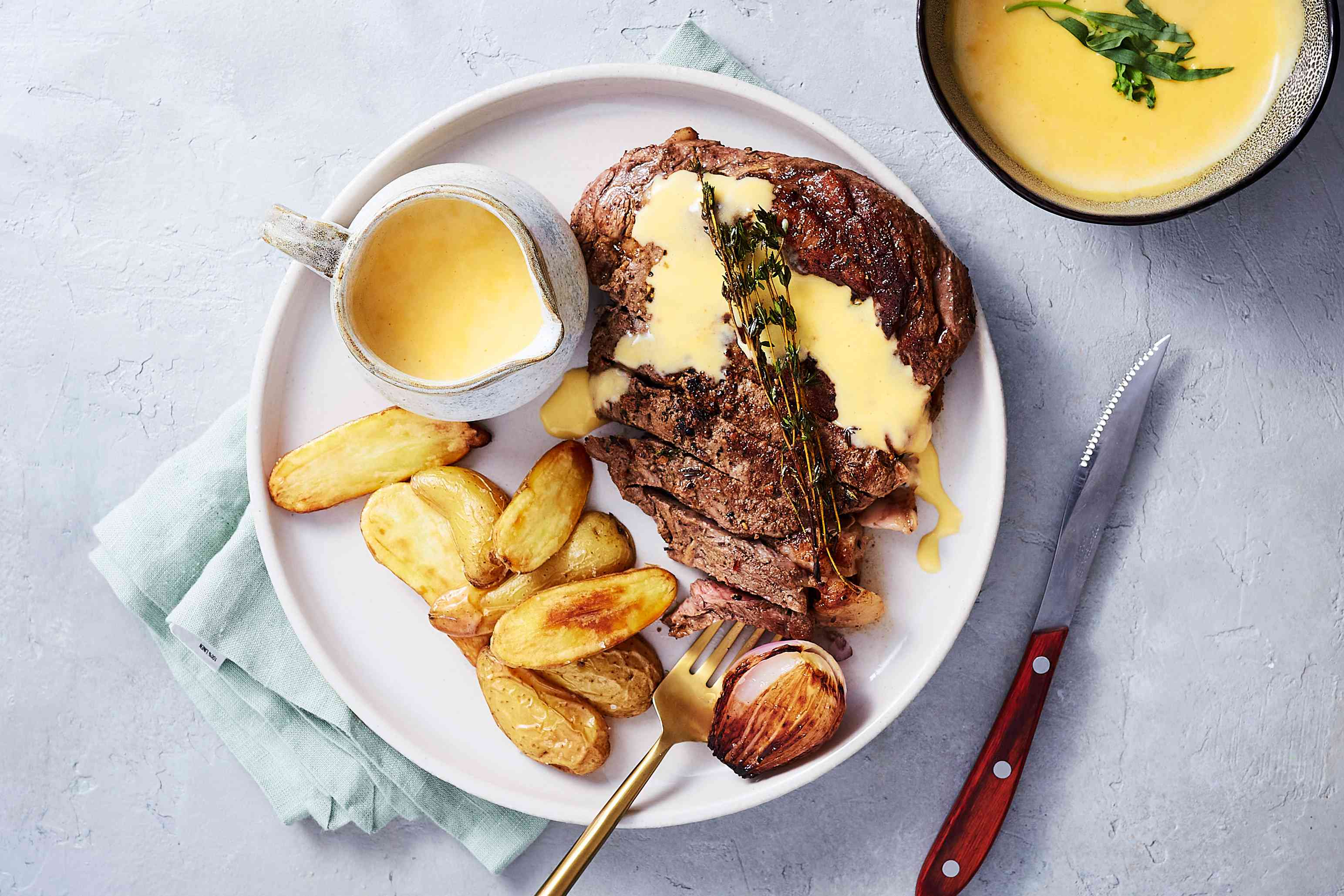Classic Bearnaise Sauce, served with a steak and potatoes