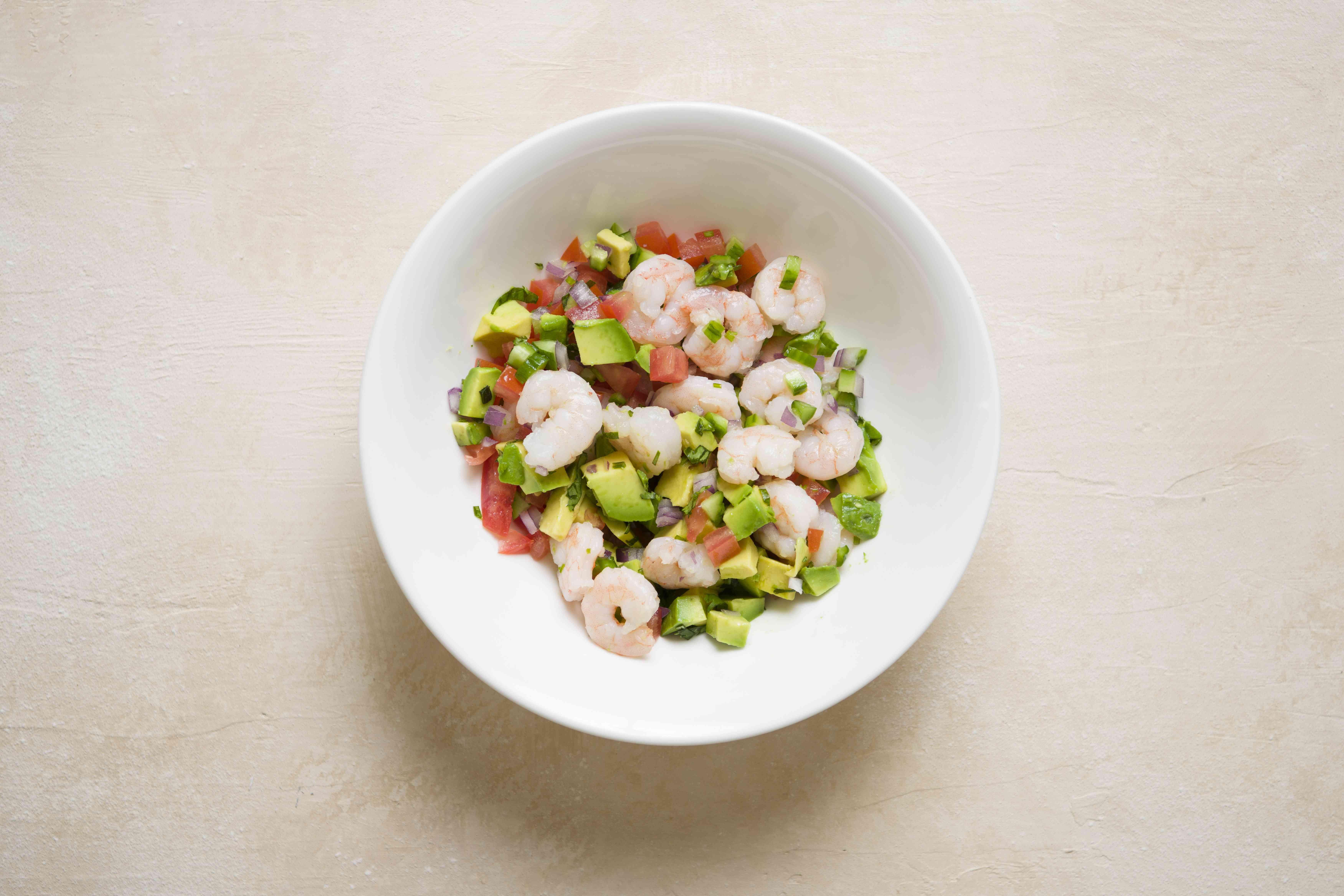 shrimp, onion, cucumber, tomato, avocado, and cilantro in a bowl