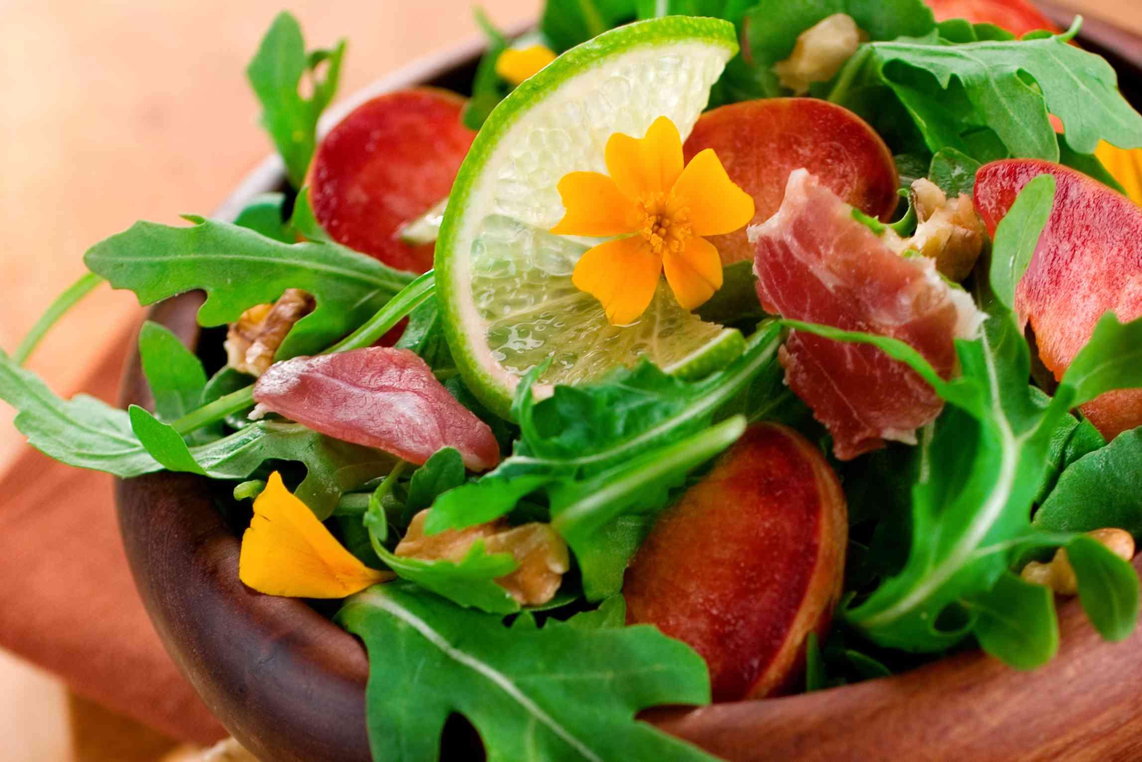 Pluots in an arugula salad