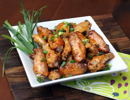 Cajun spiced chicken wings with green onions.