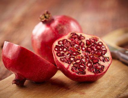 Pomegranate fruit on cut board