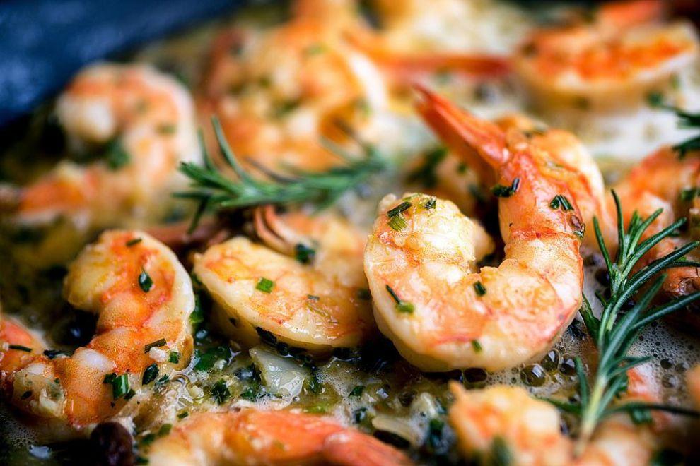 Marinating the rosemary garlic shrimp before grilling