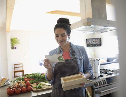 Woman reading a recipe card