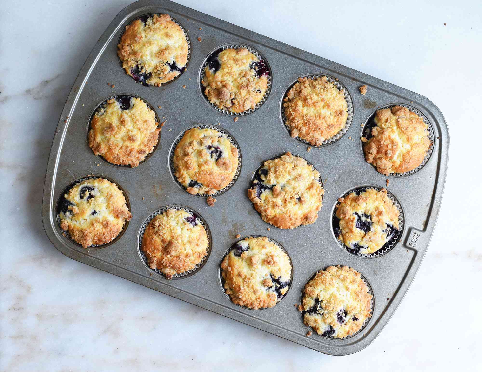 baked blueberry muffins in a muffin tin
