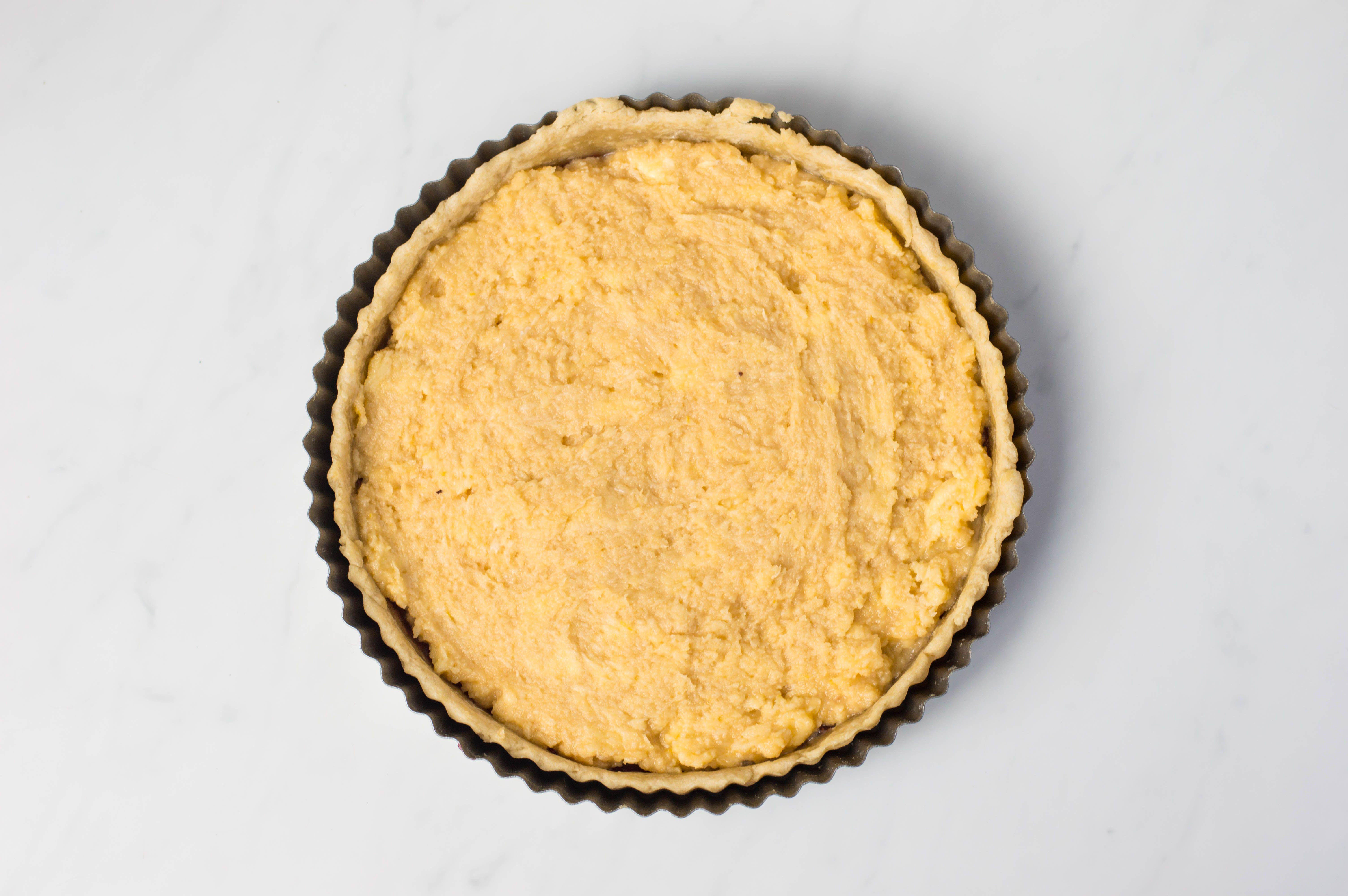 Tart pan filled with almond mixture