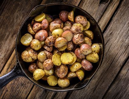 A skillet filled with roasted Yukon Gold potatoes