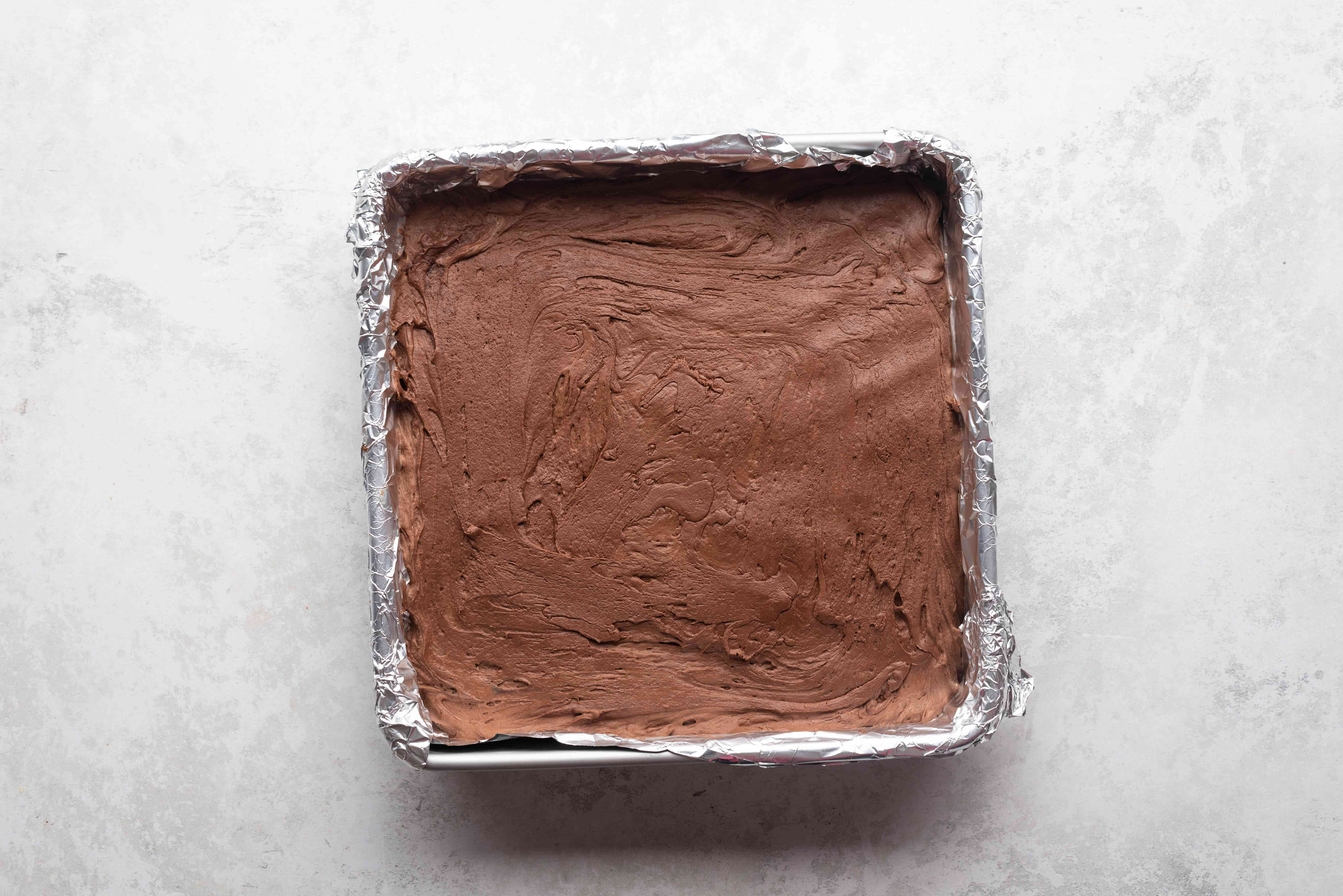 chocolate marshmallow mixture in a prepared baking pan