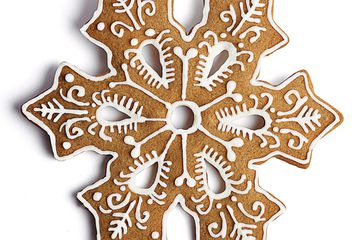 Gingerbread cookie iced with royal icing to look like a snowflake