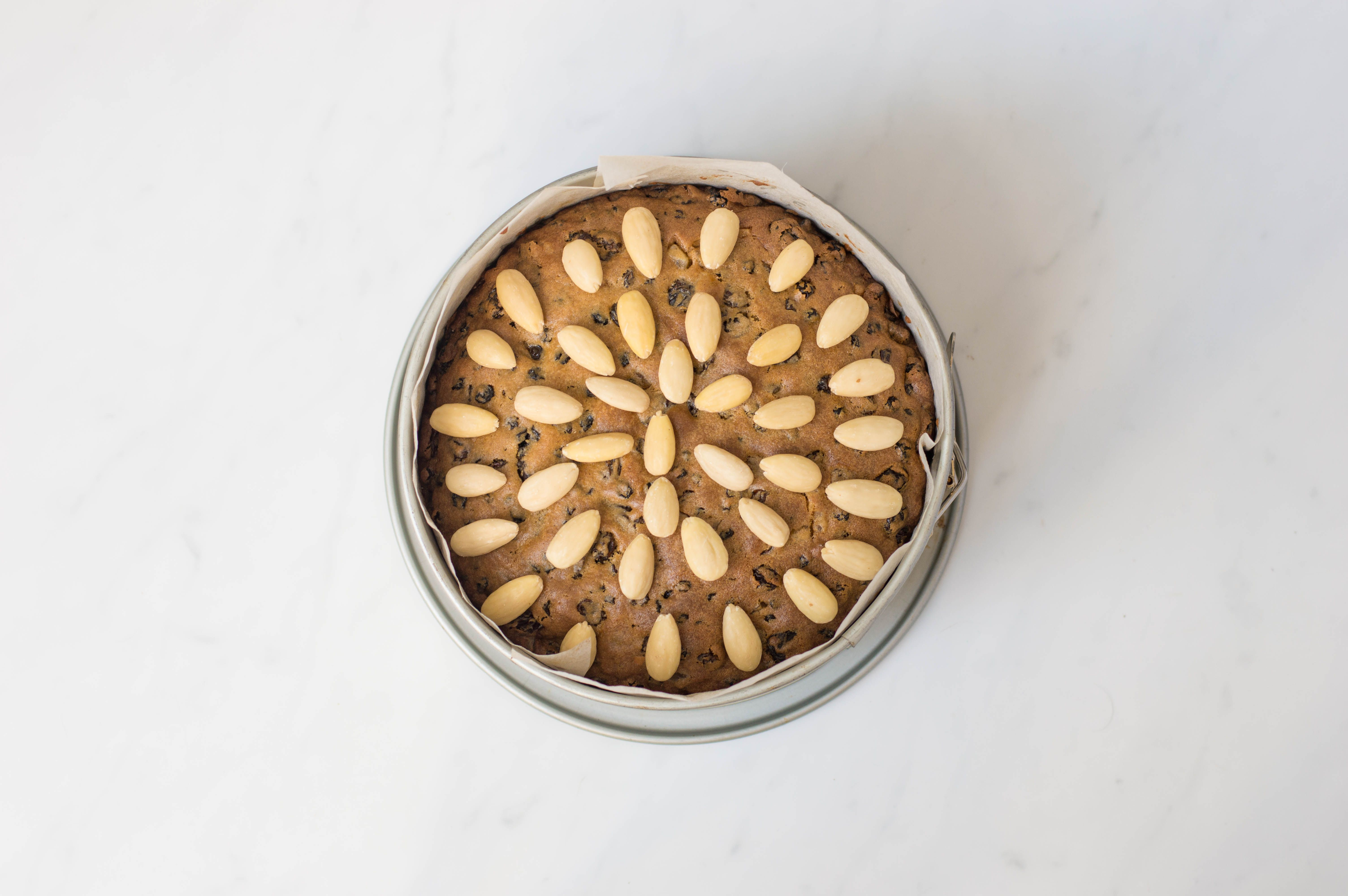 Cook Scottish dundee cake and add almonds to top